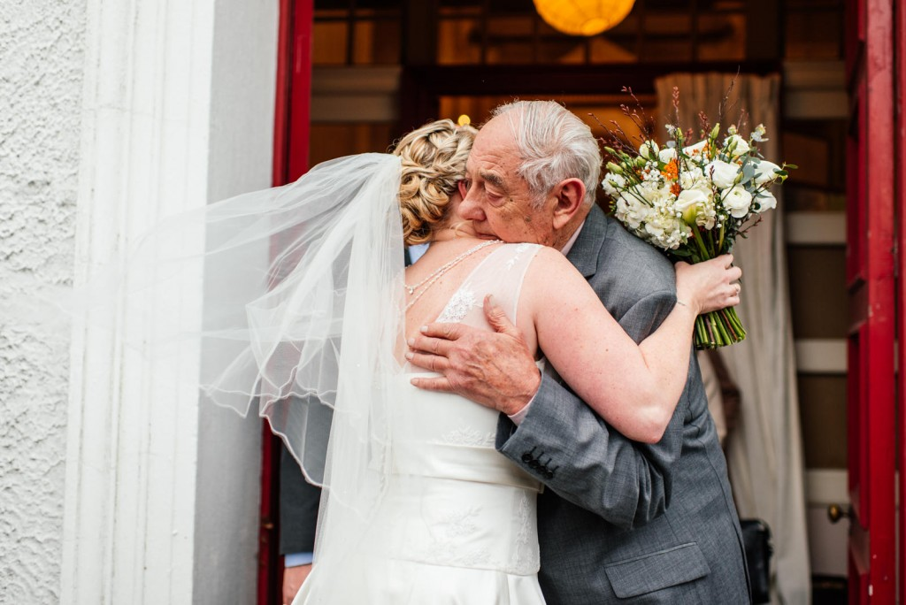 Grandfather Hug at Wedding