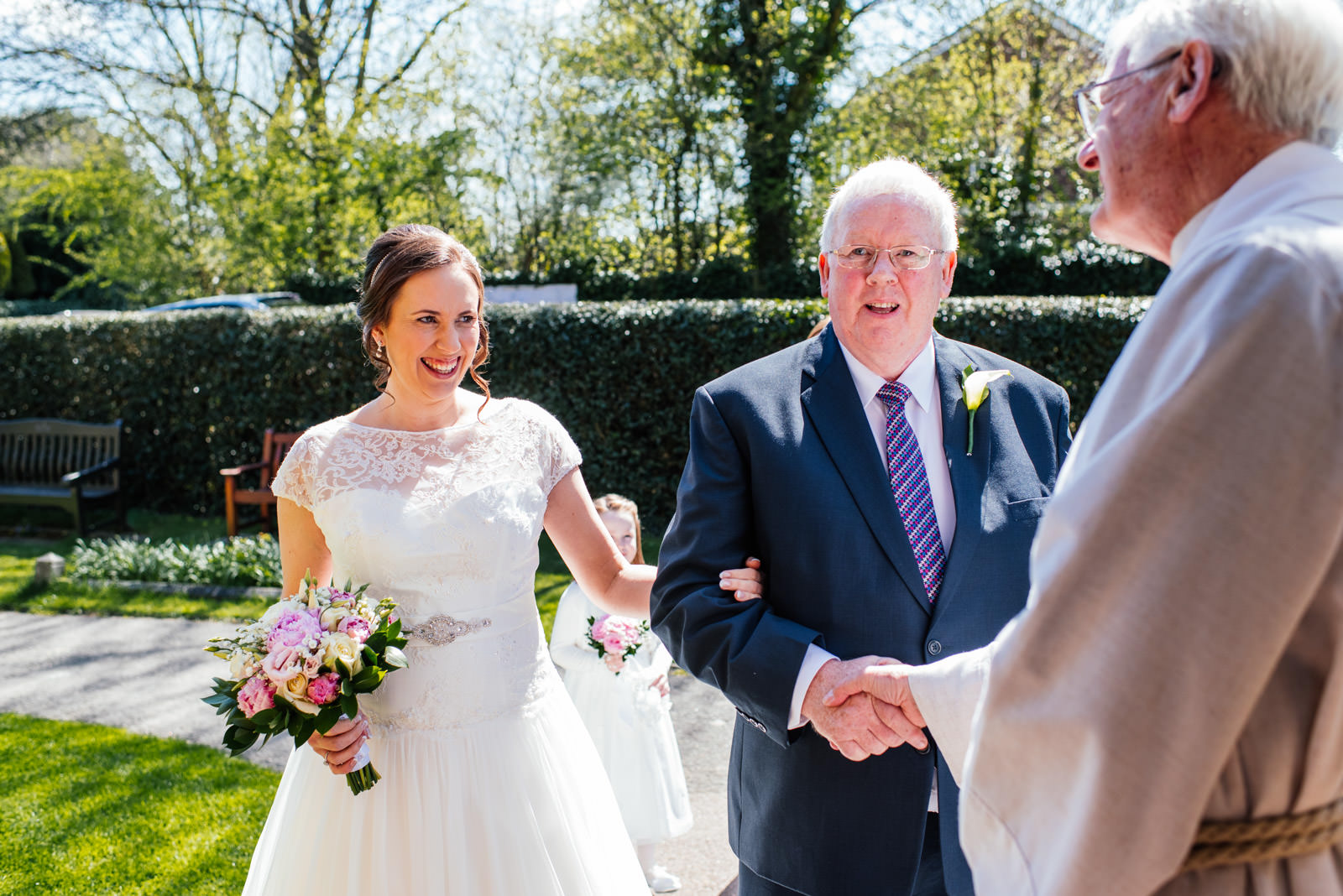 Bride and father greeted by vicar