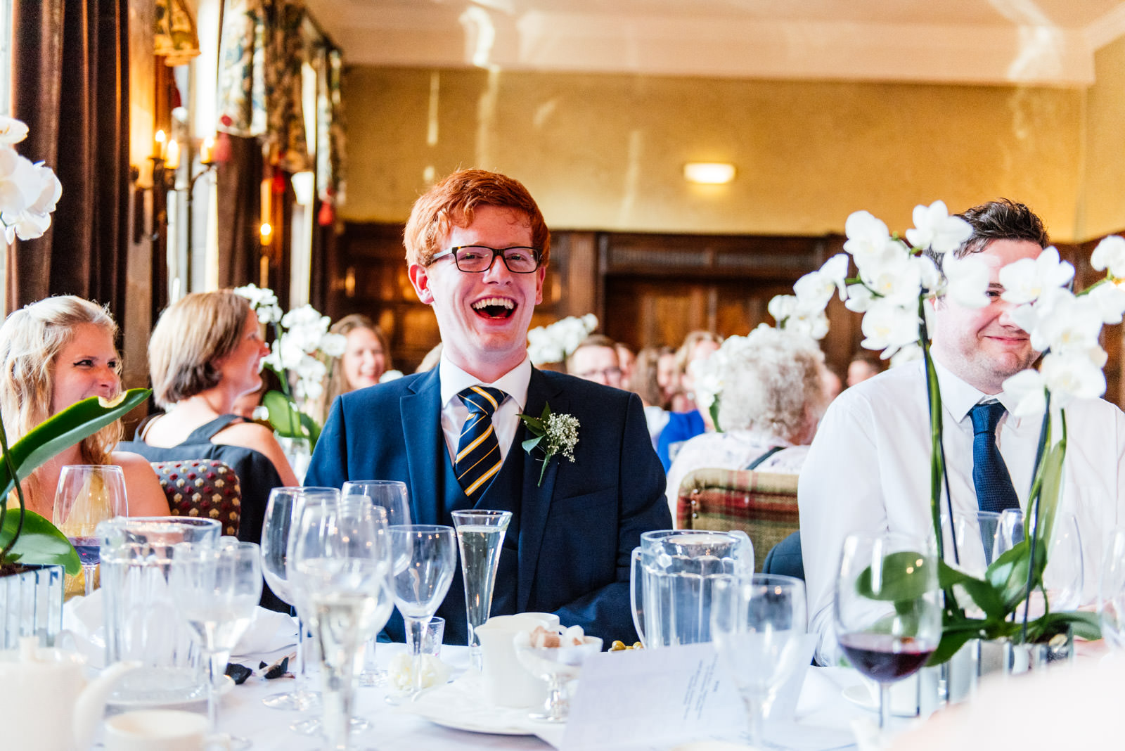 Guest laughing during wedding speeches