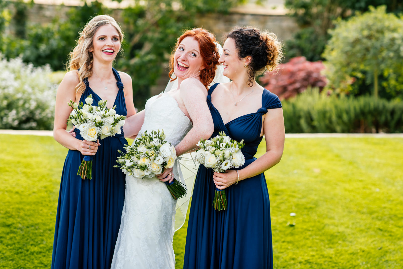 Bride and bridesmaids fun group photo
