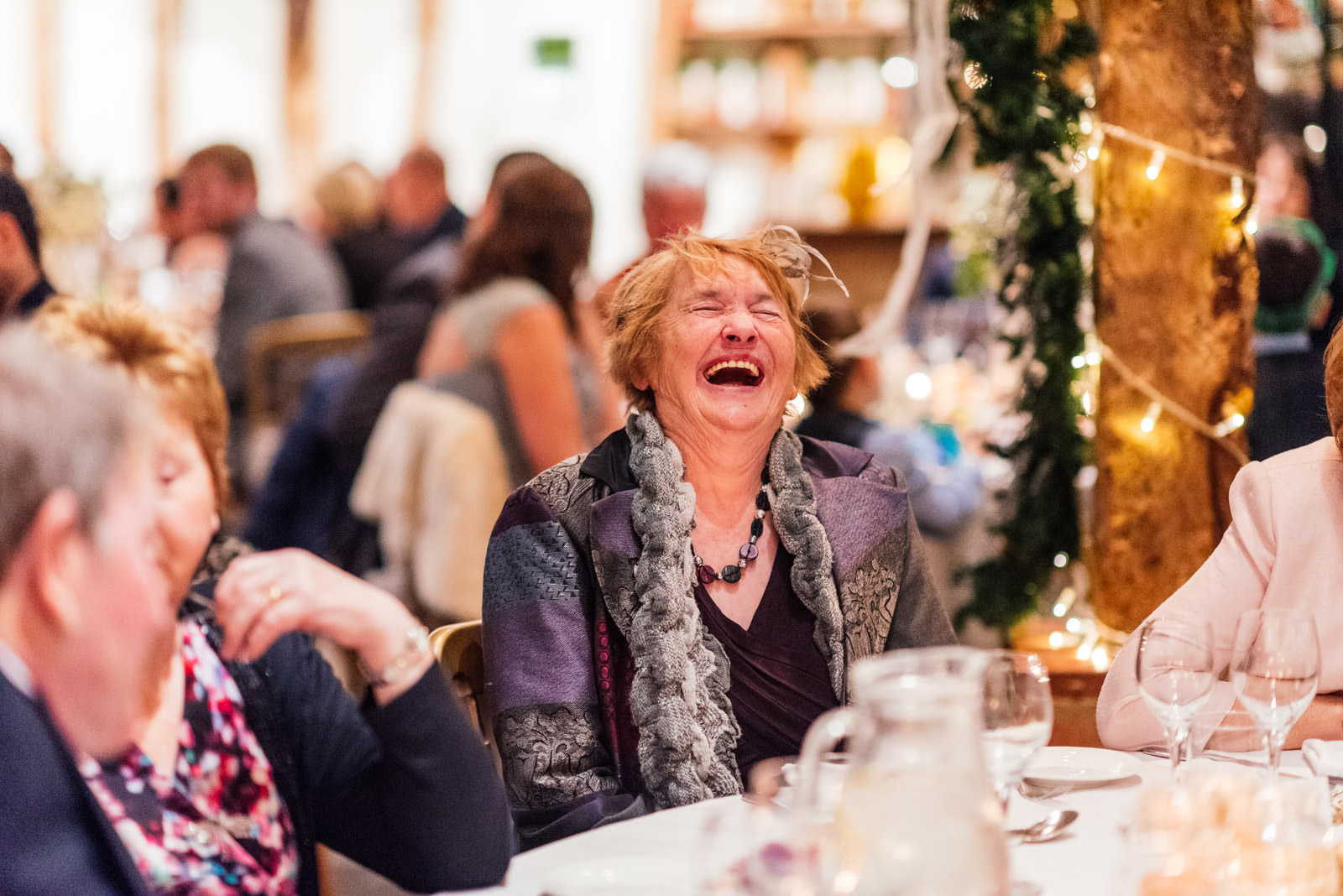 Guests laughing to speeches