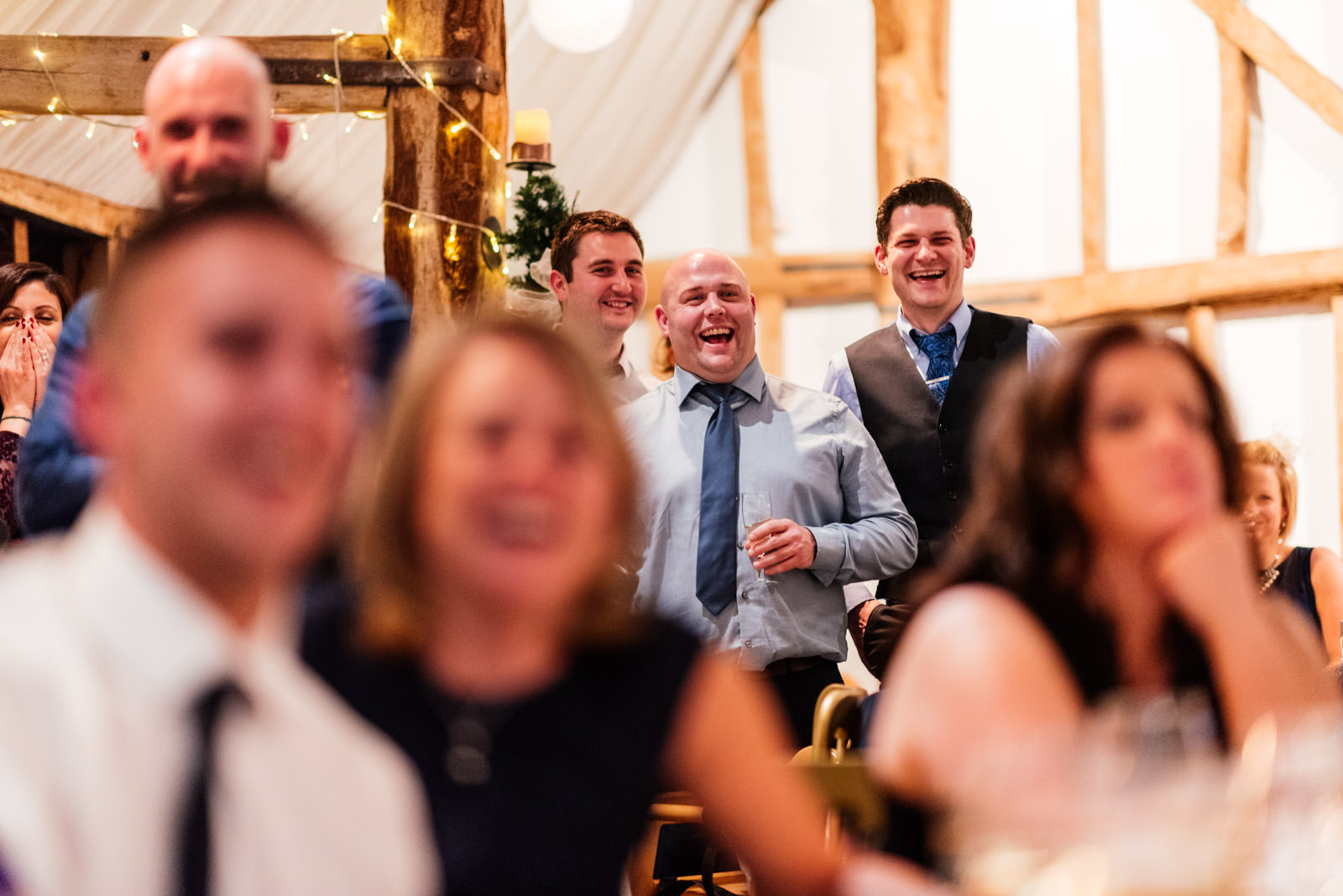 Guests laughing at best man speech
