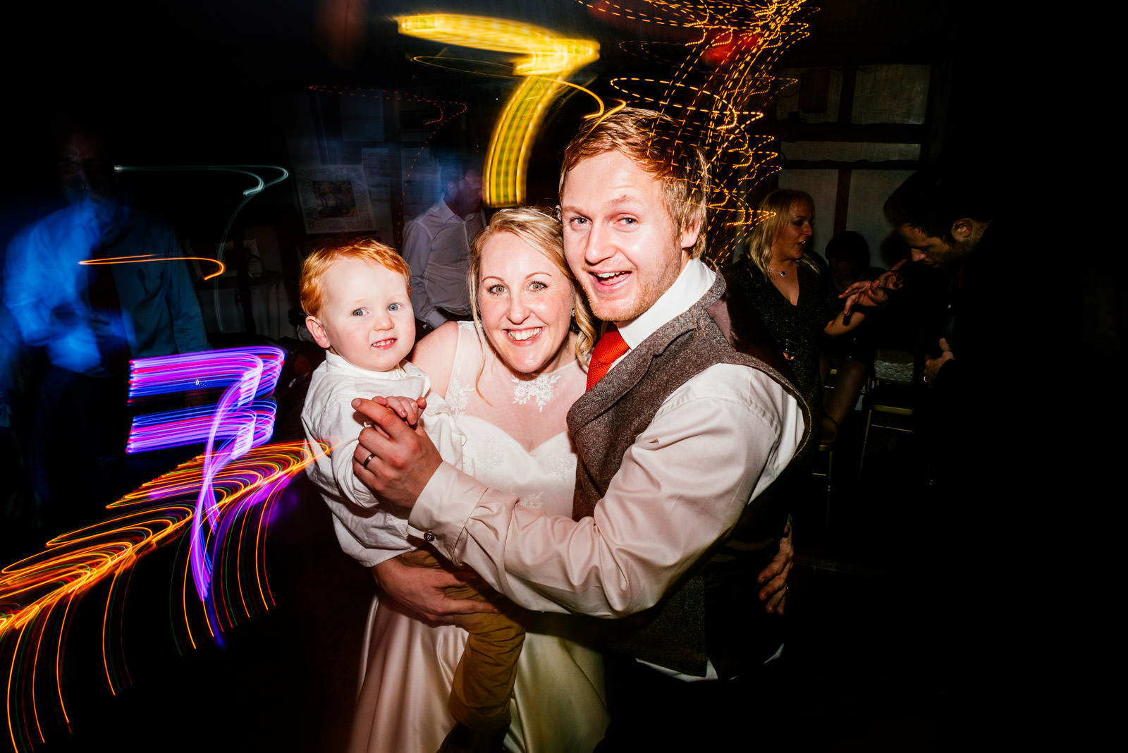 Bride, Groom and Son on wedding day