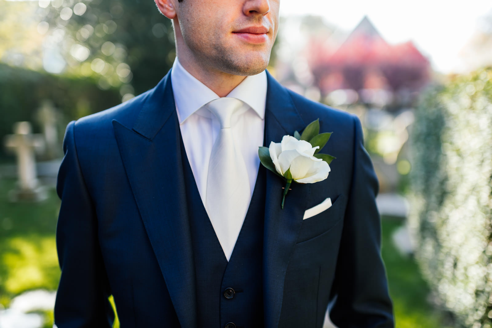 Groom button hole flower tie and suit detail