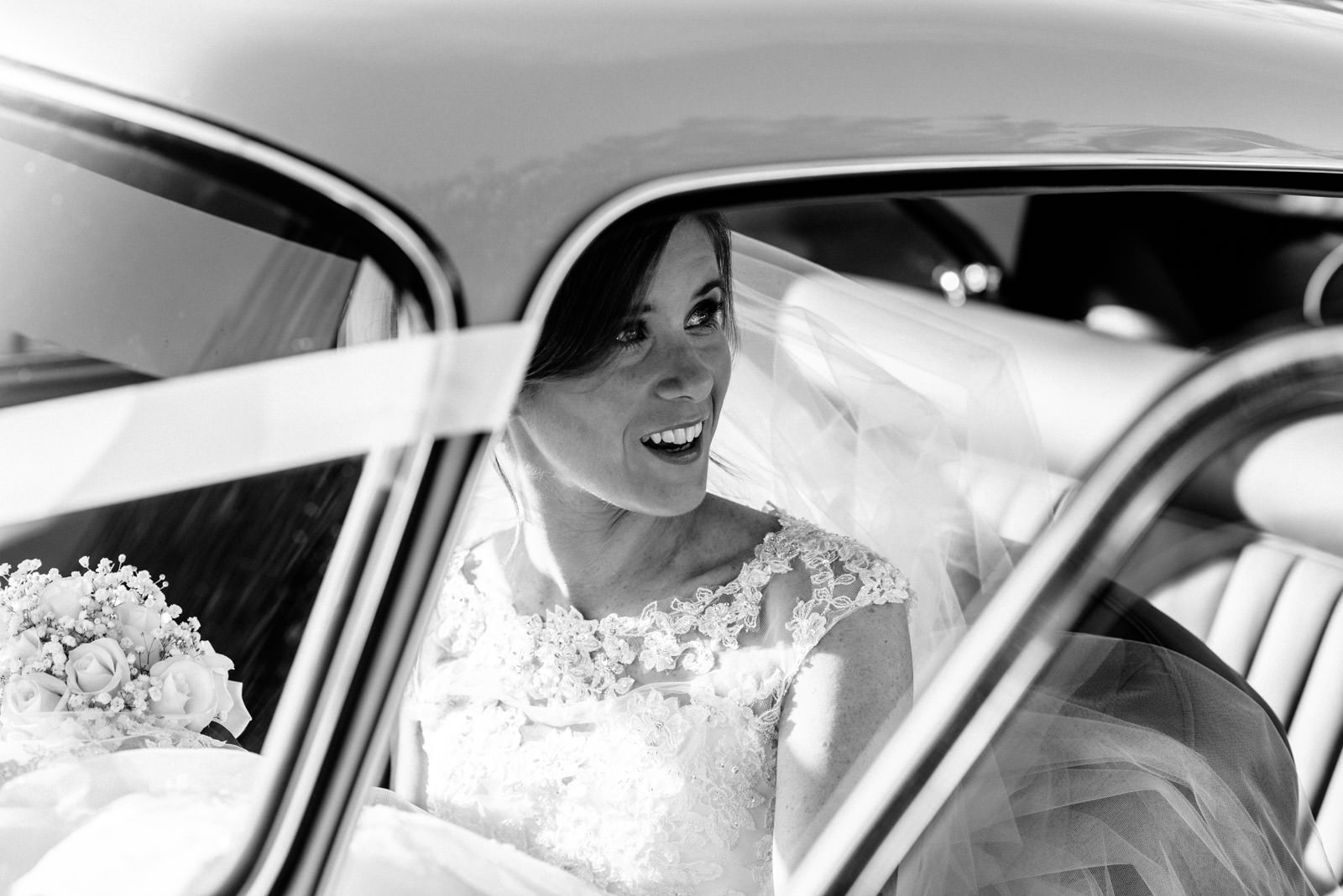 Bride in Aston Martin wedding car