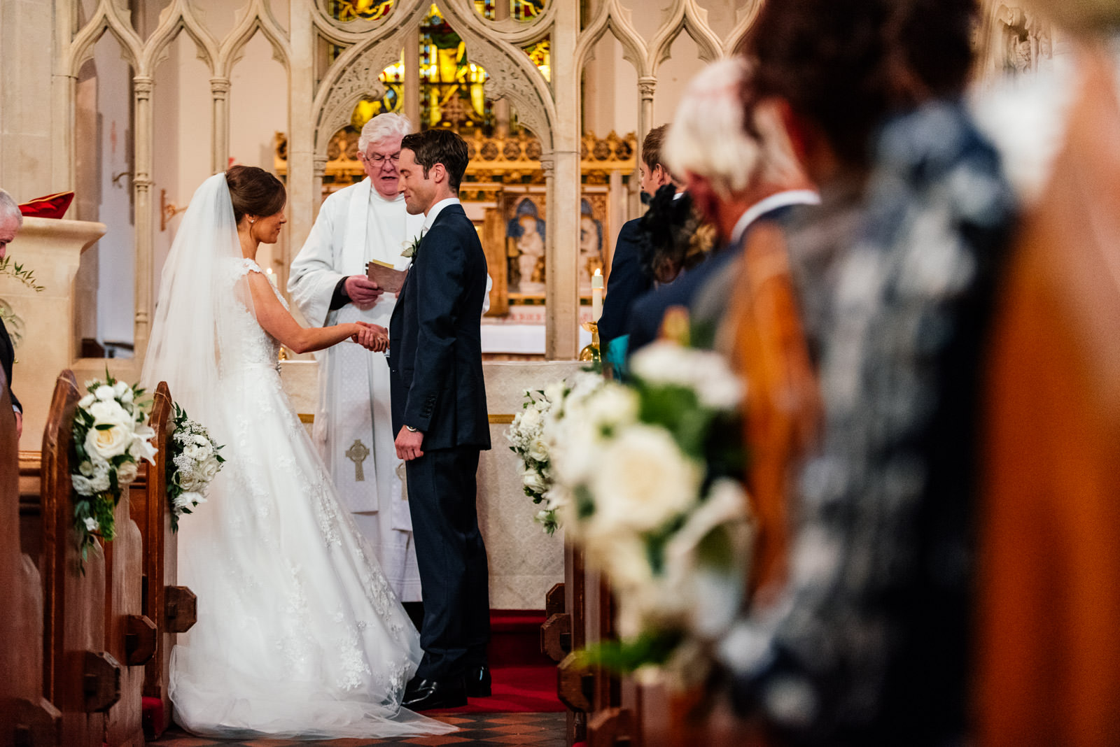 Bride and groom exchanging vows in church