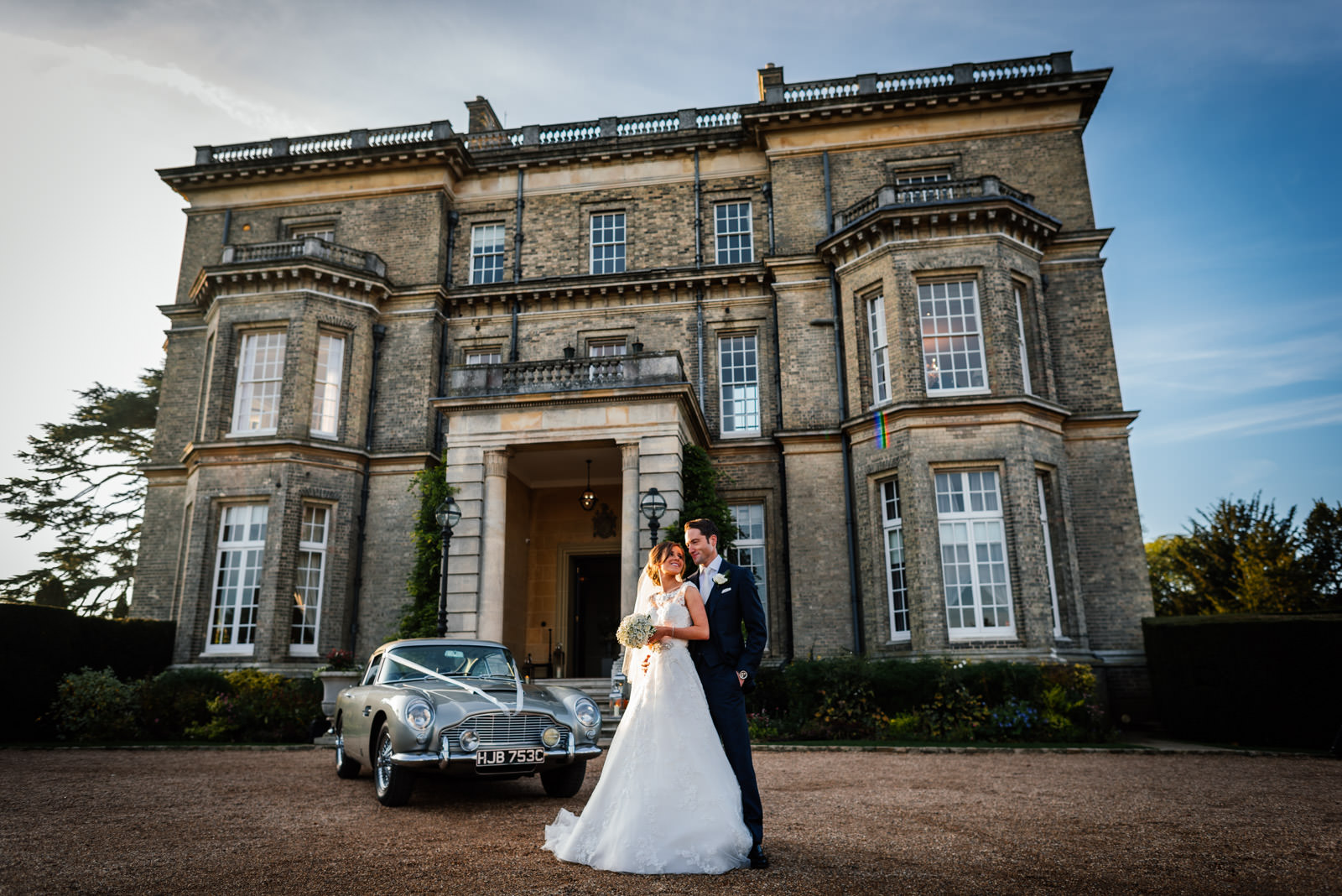 Bride & Groom portrait in front of Hedsor House and Aston Martin