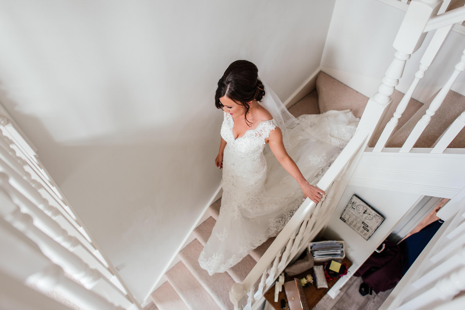 Bride walking down the stairs in wedding dress