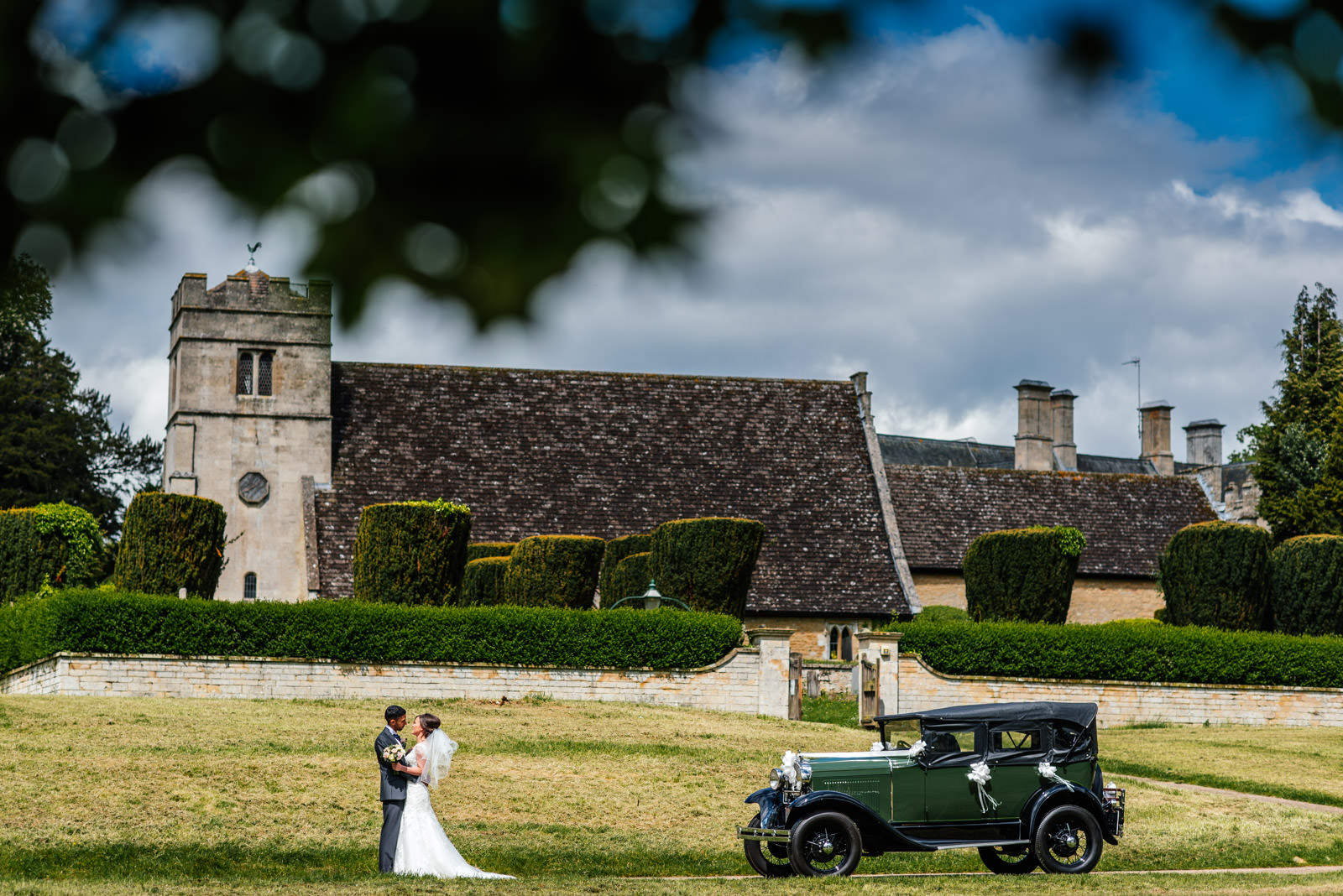 Church bride and groom and vintage car