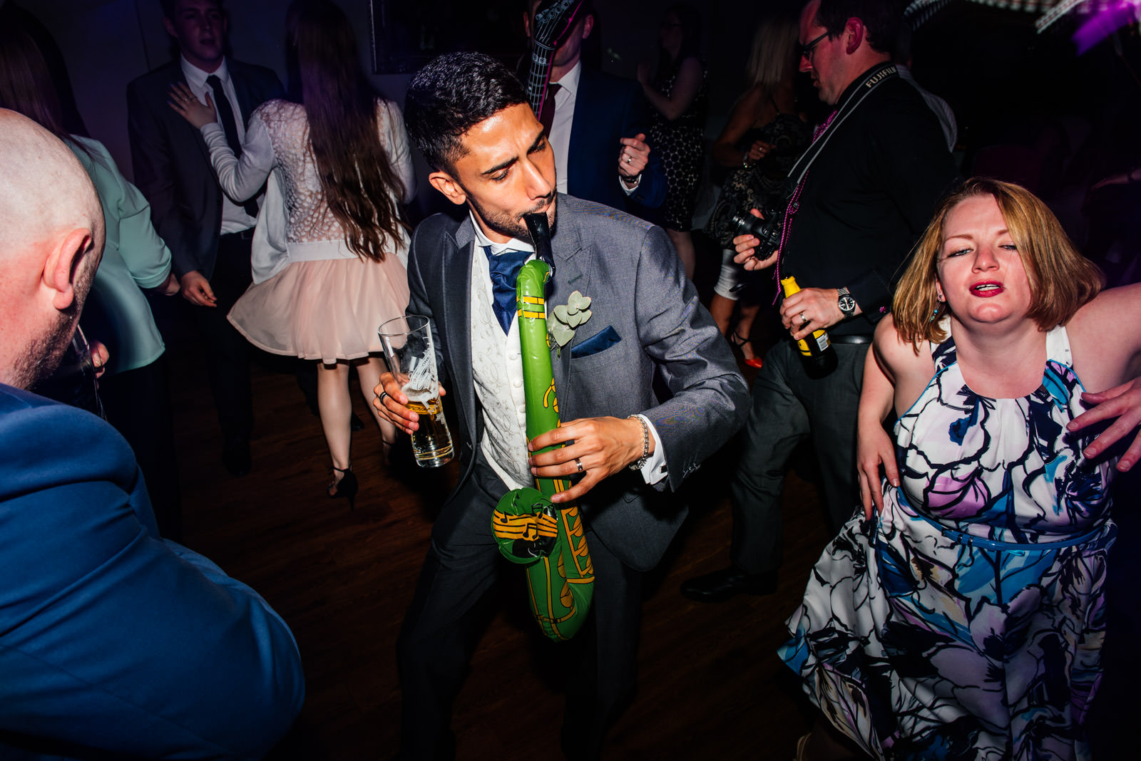 Groom with inflatable saxophone