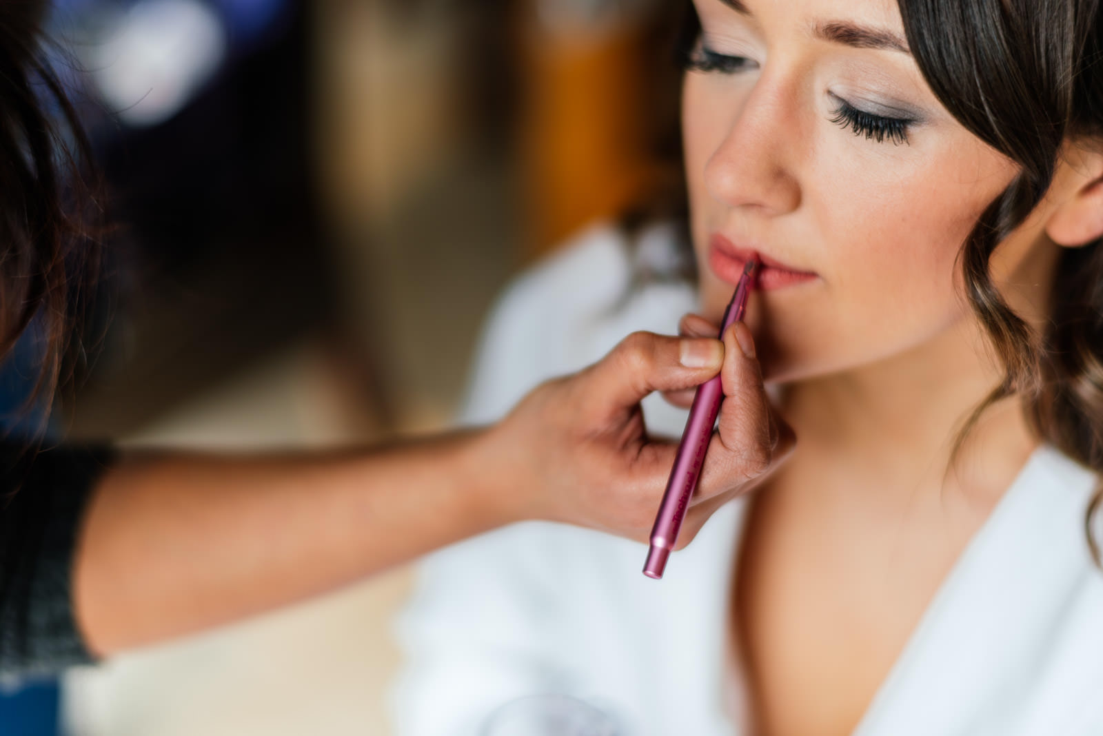 Bride lipstick being applied