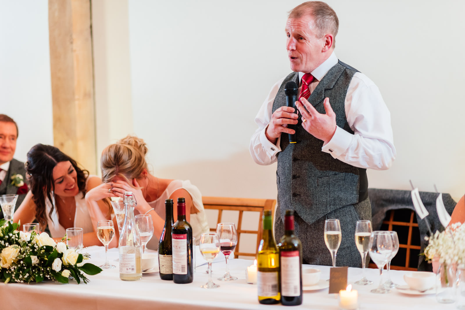 Brides father telling embarrassing story during speeches