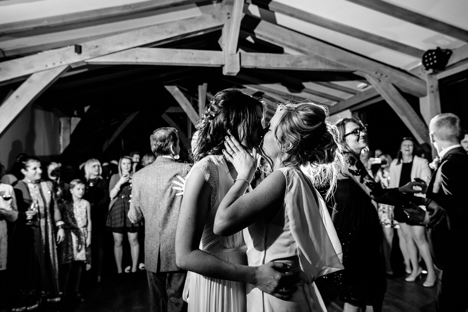 Brides kiss during first dance