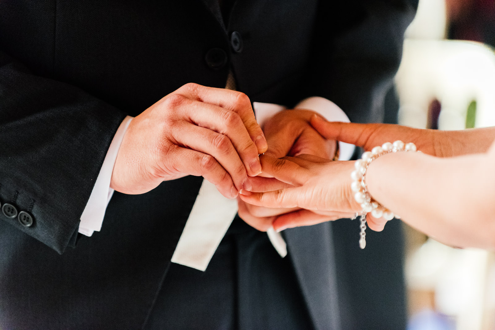 exchanging rings during marriage ceremony