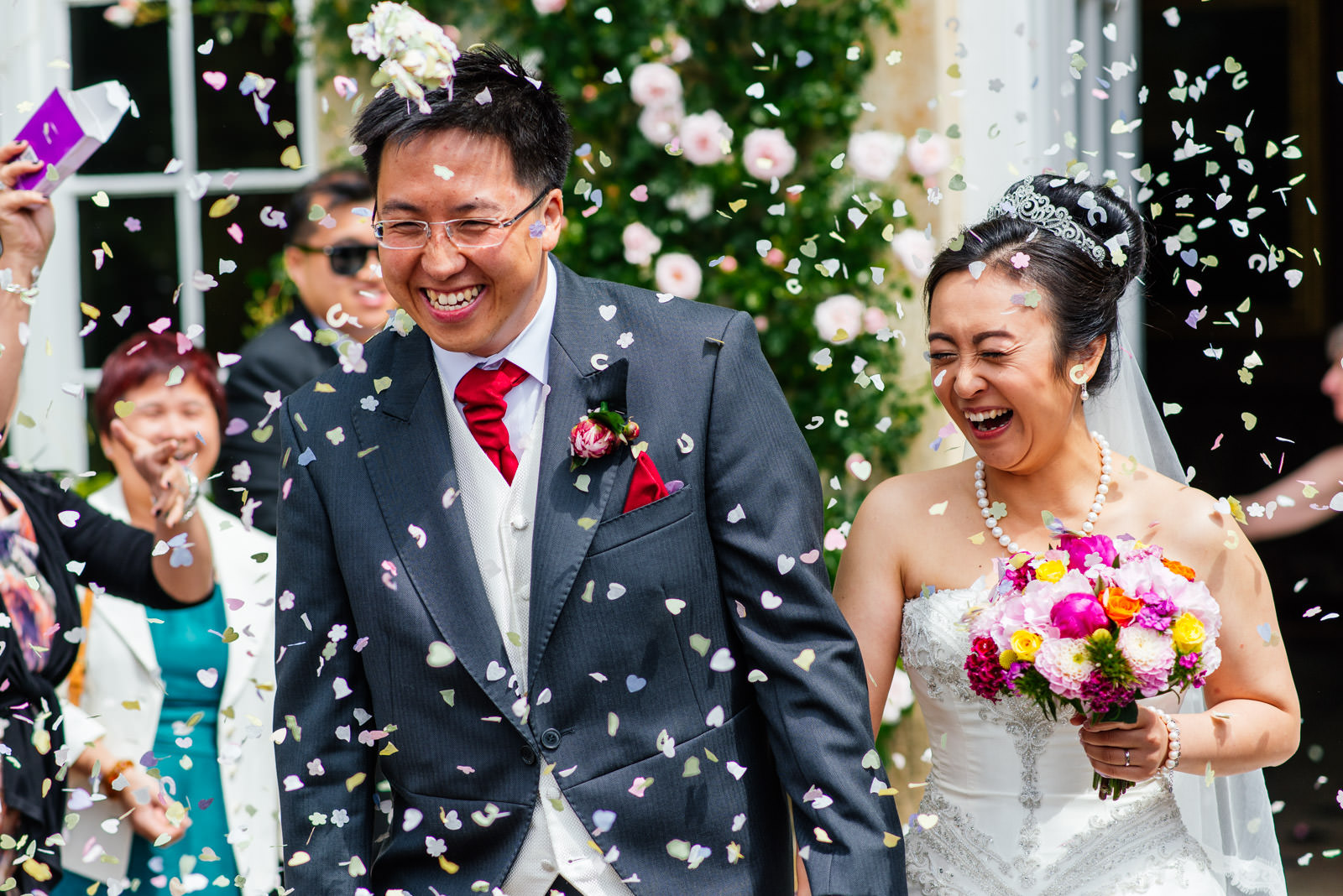 bride and groom with confetti thrown at them