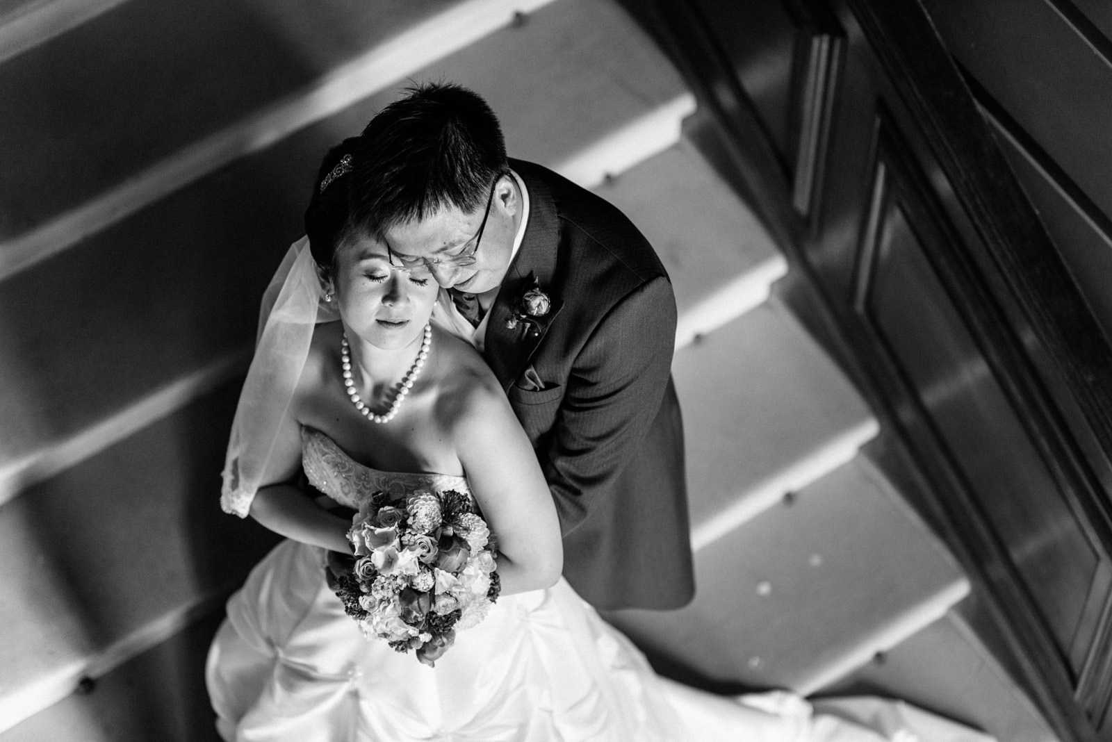 bride and groom black and white portrait on stairs