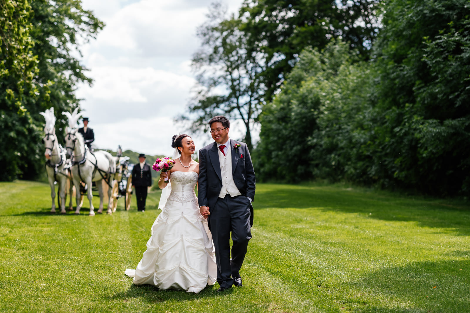 bride and groom portrait with horse and carriage