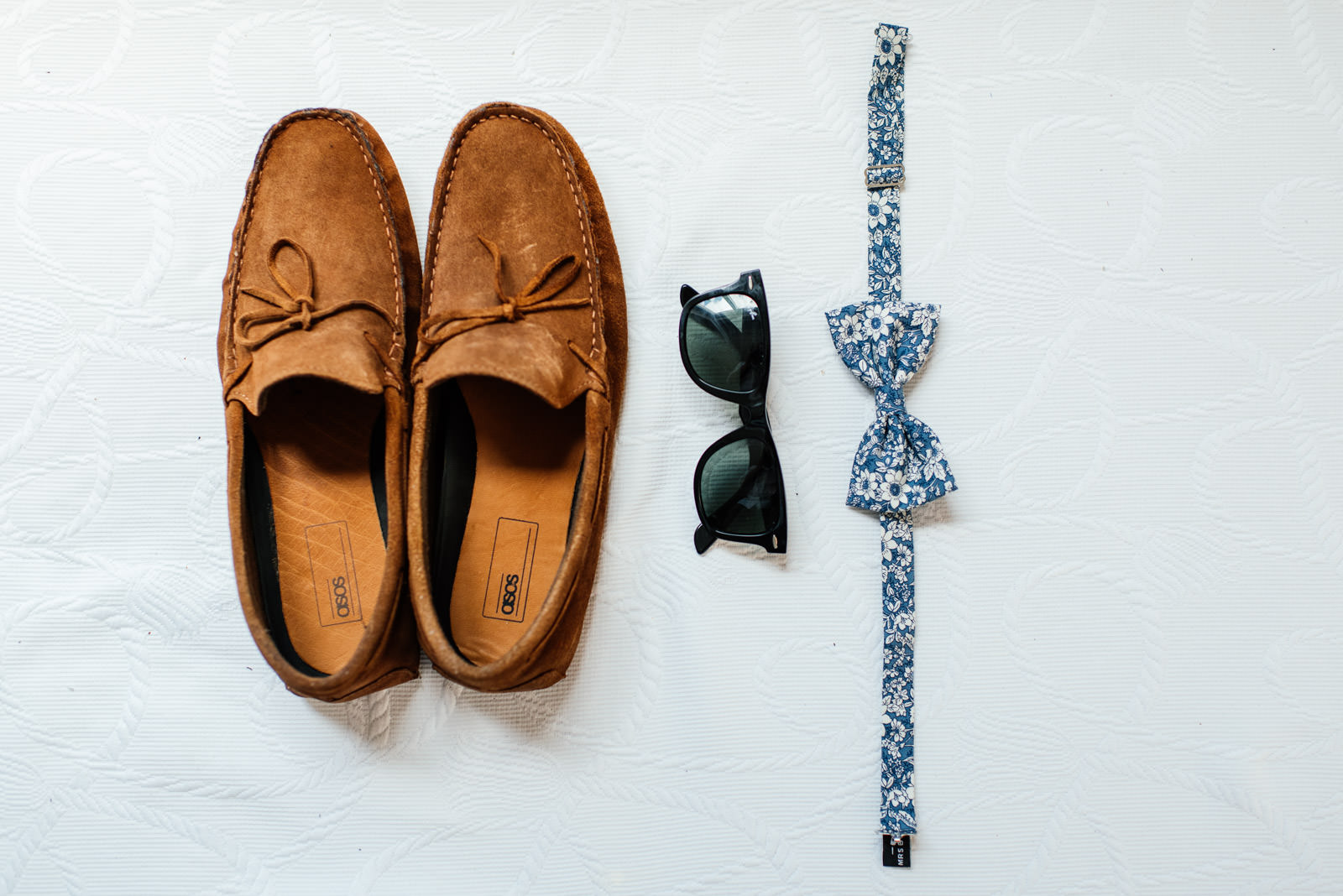 Groom details shoes, sun glasses and bowtie