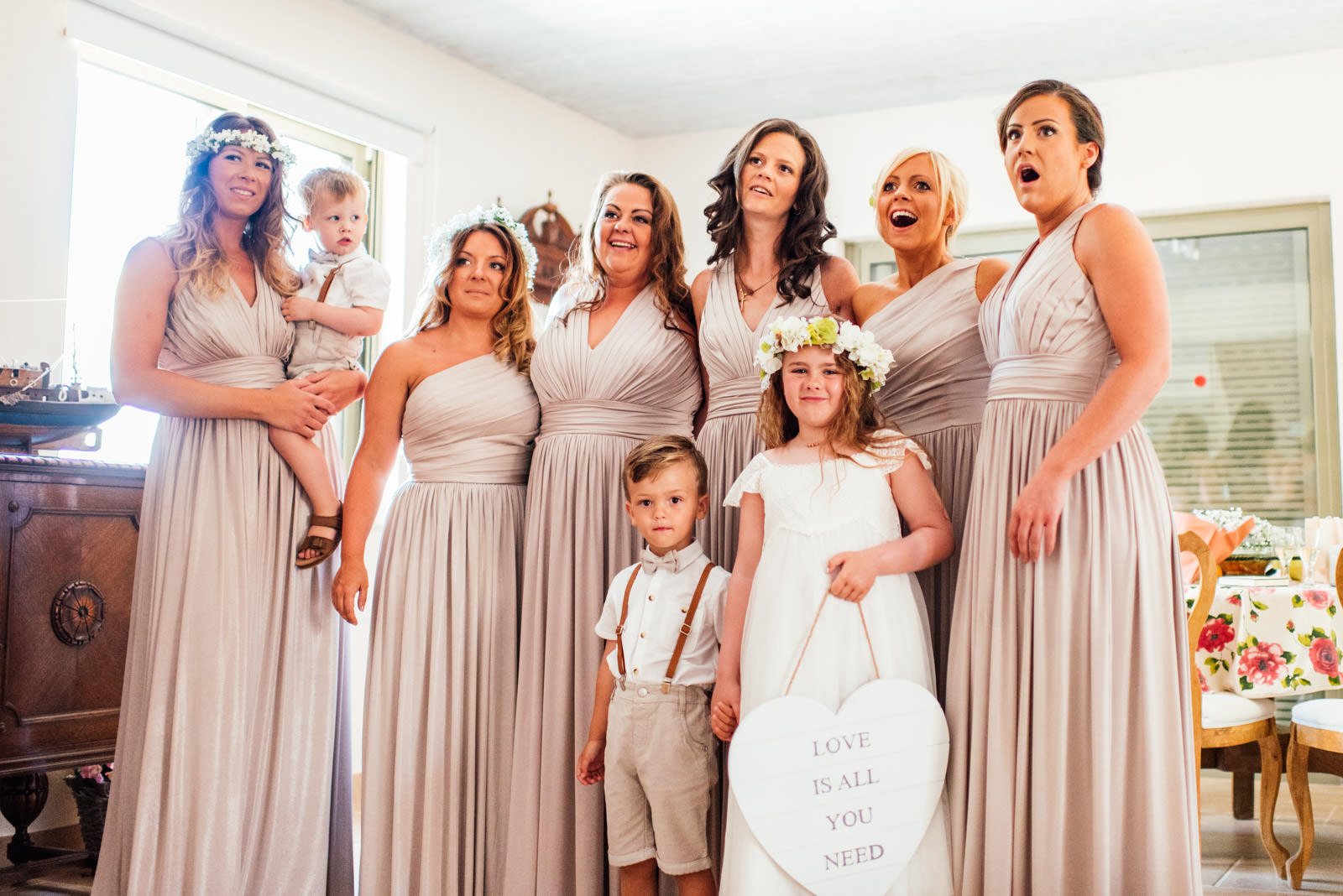 bridesmaids react to seeing bride for the first time.