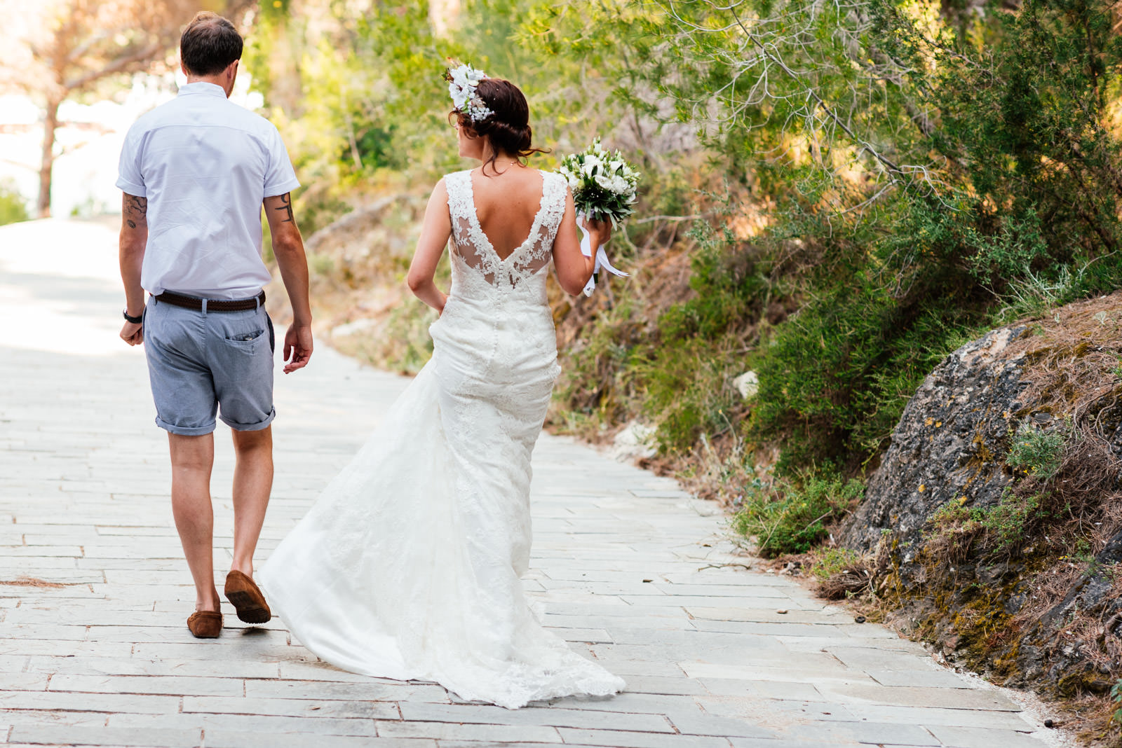 bride and groom head back to Assos village
