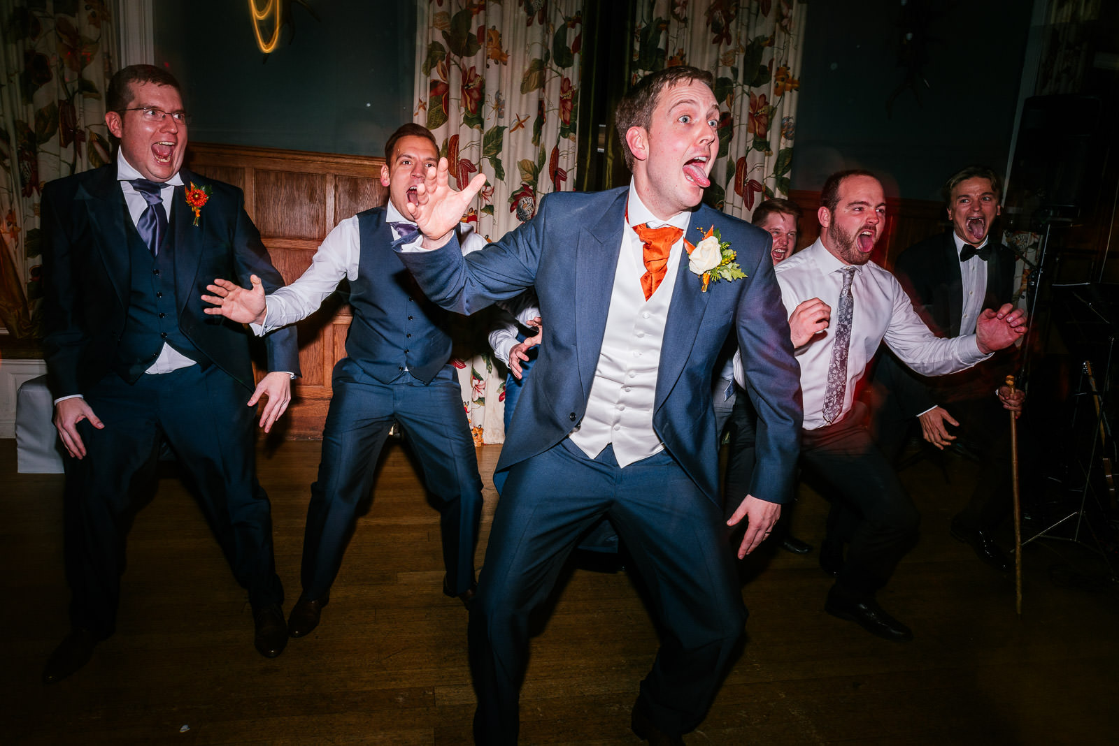 groomsmen having a dance off