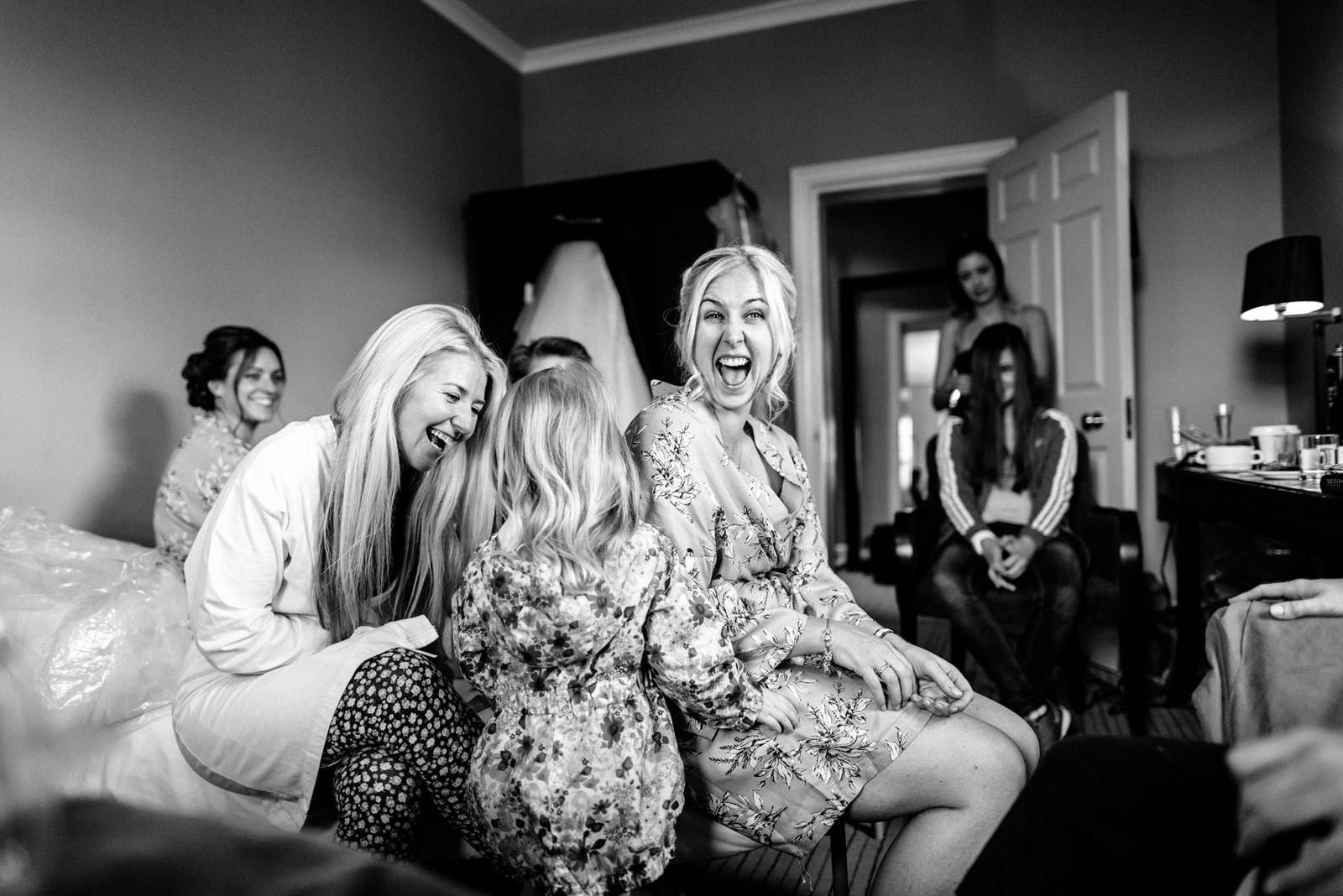 bridesmaids laughing during morning prep