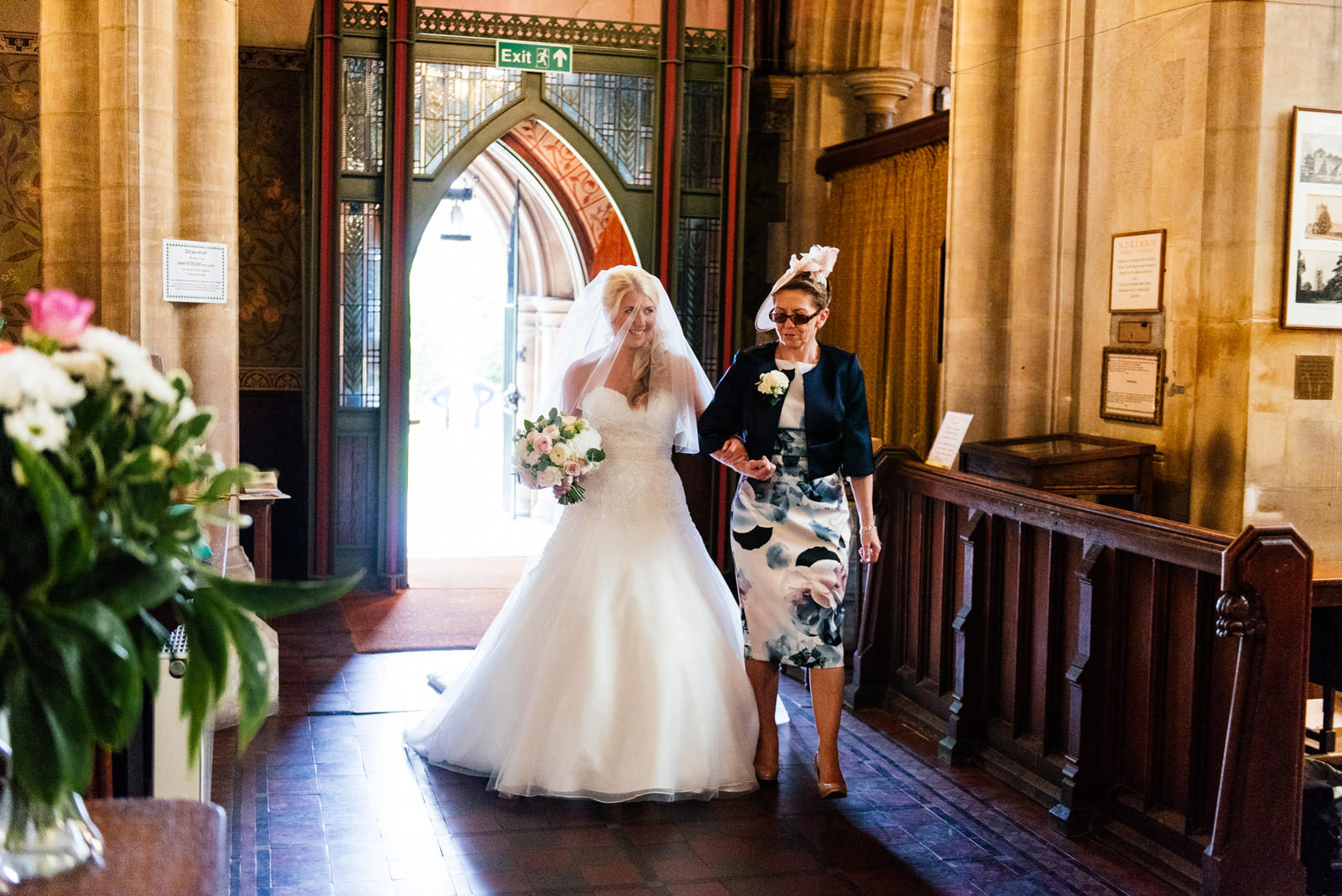 bride's entrance to church with her mother