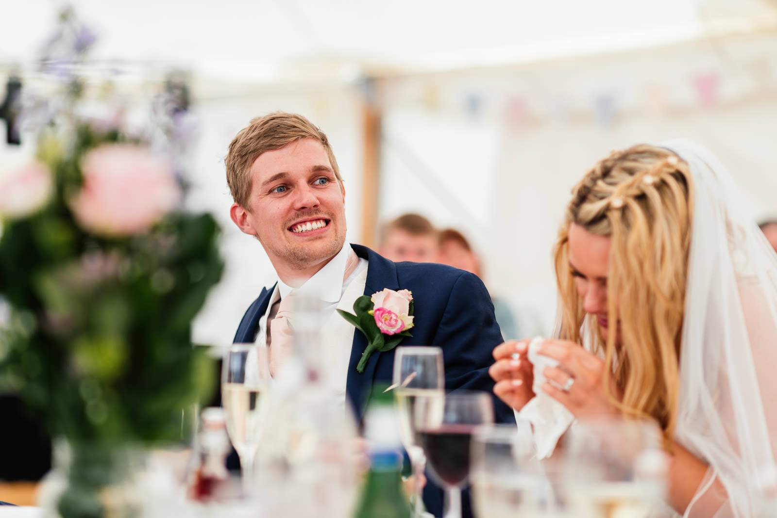 groom listening to wedding speeches