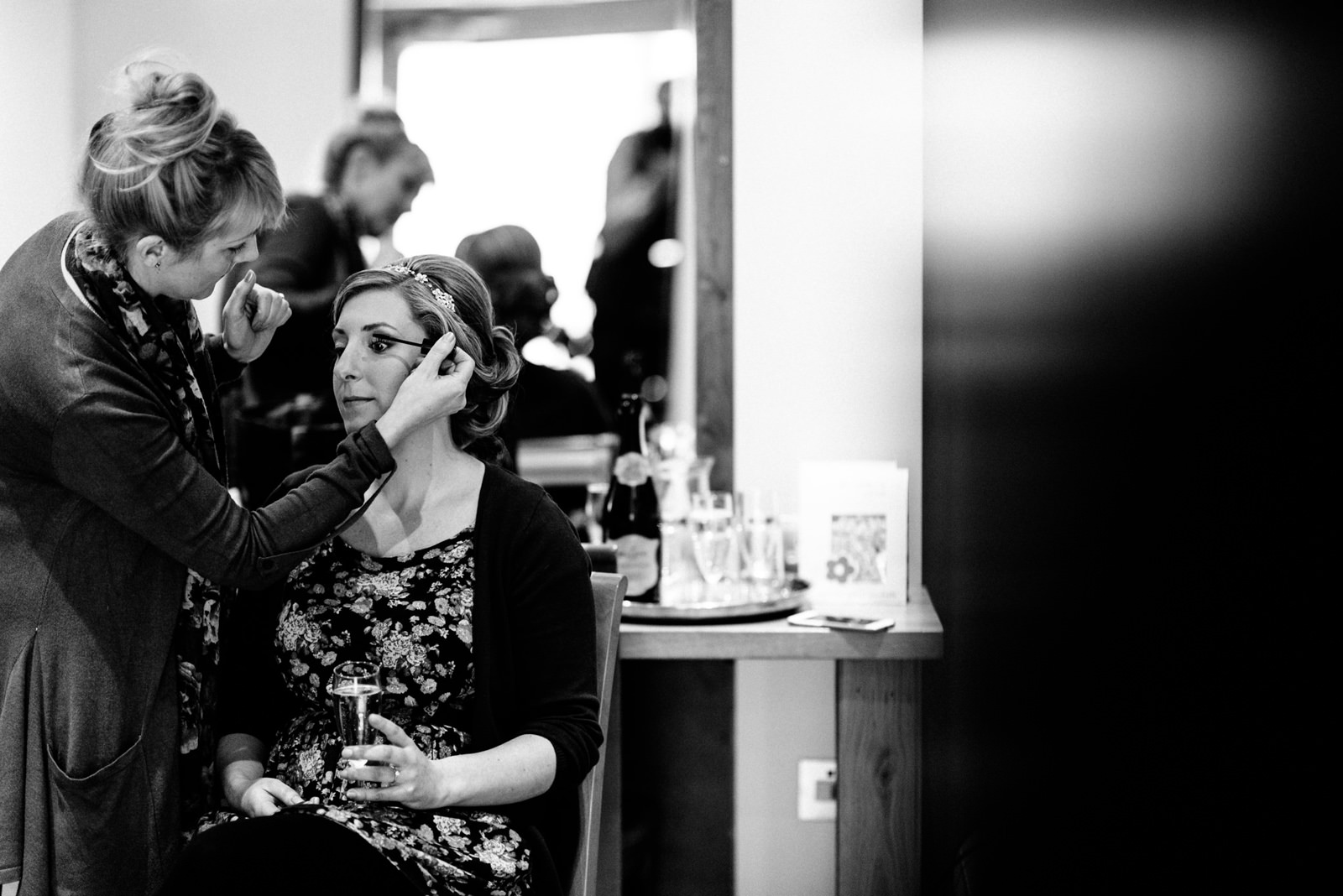 Bride having hair and make-up