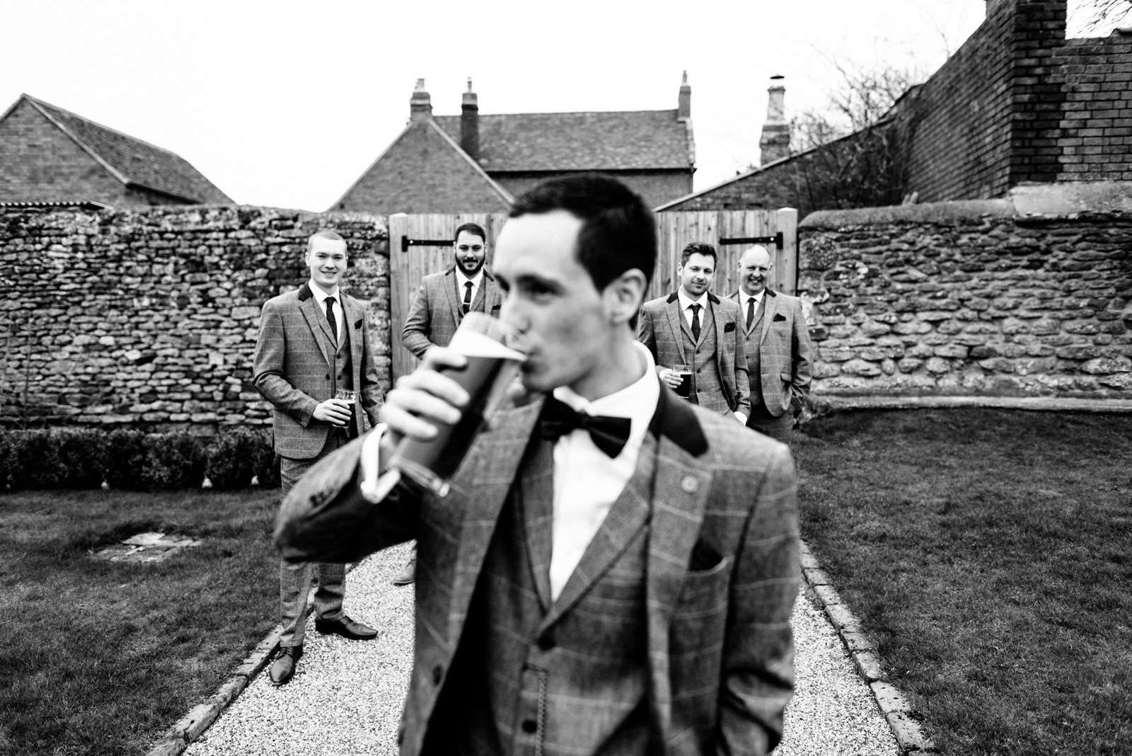 Groom drinking a pint