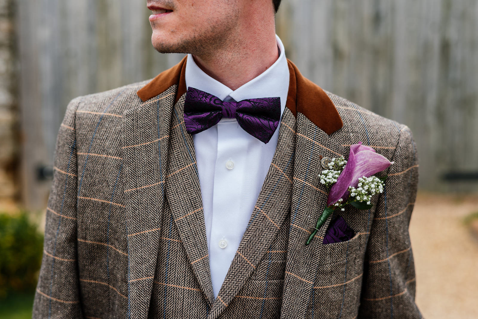 groom bowtie and button hole detail