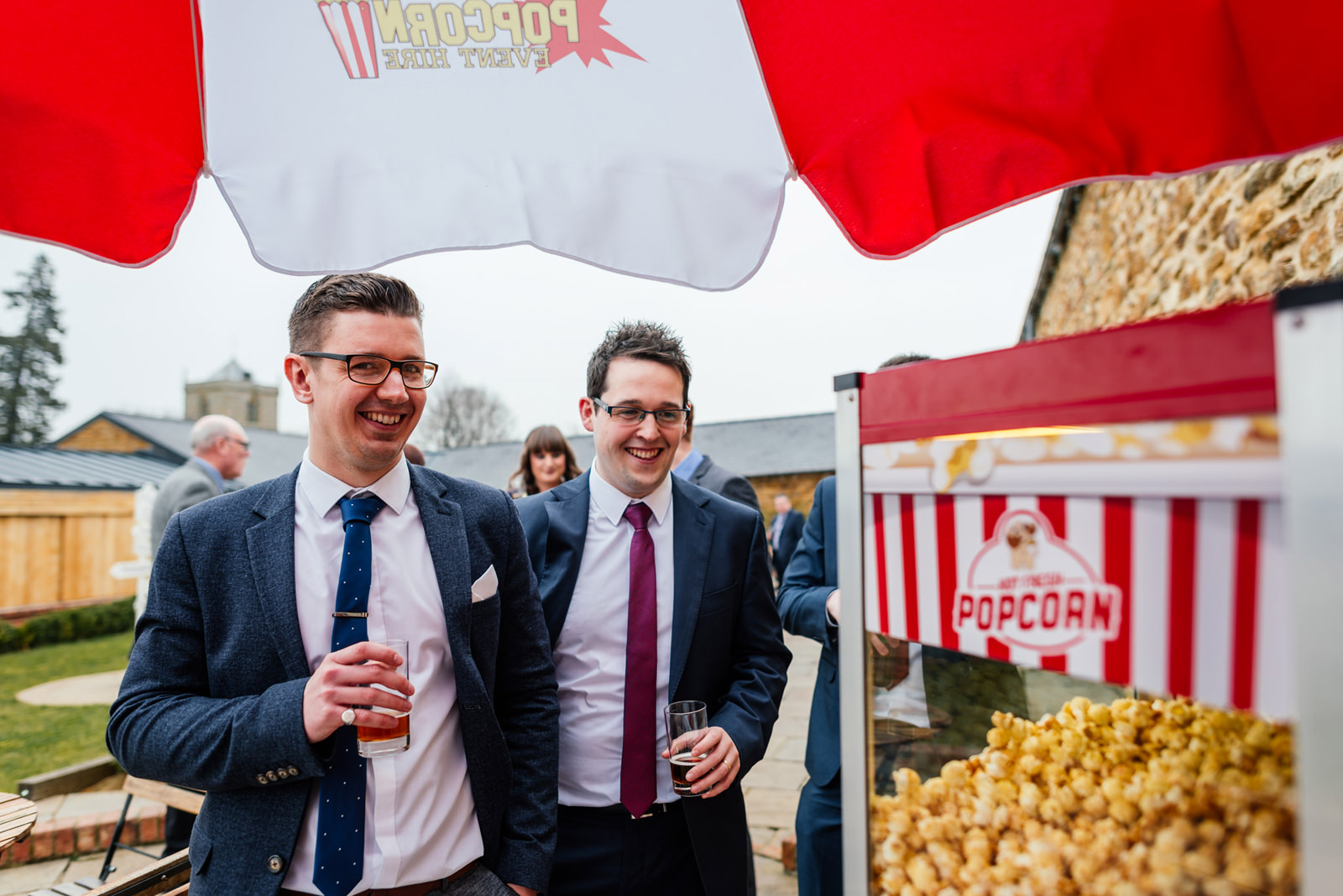 guests getting popcorn during drink reception
