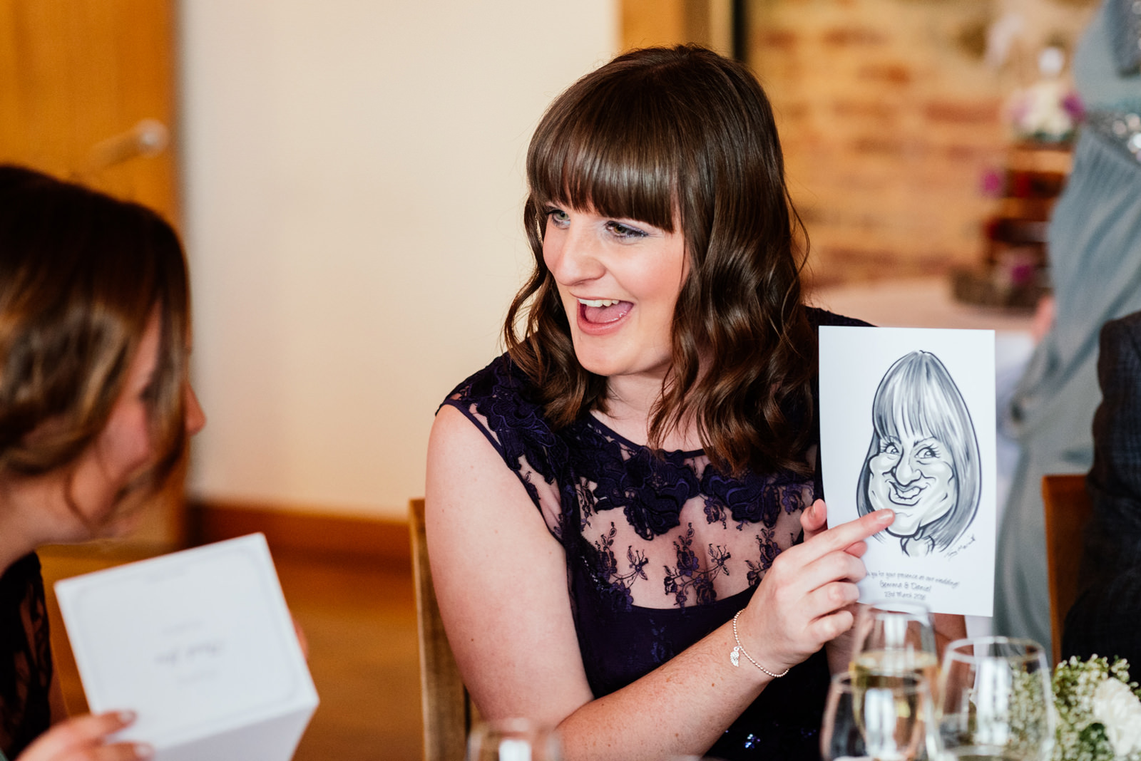 bridesmaid laughing at caricature drawing