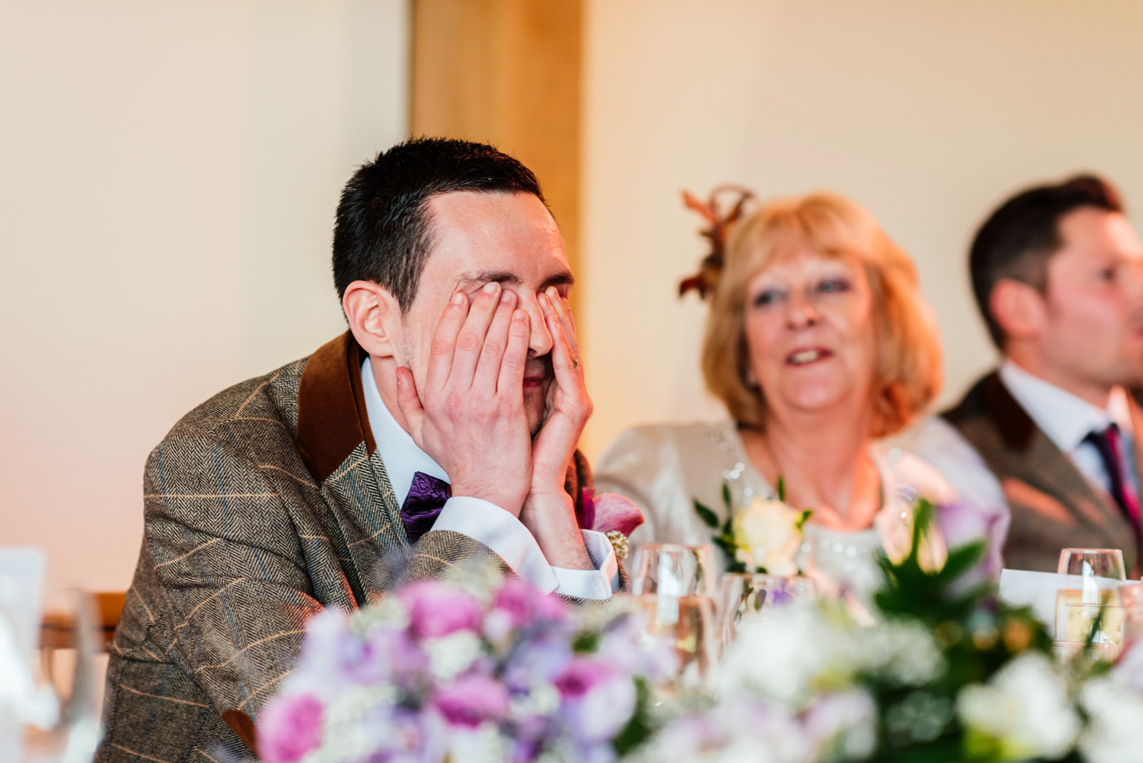groom looking embarrassed during the speeches