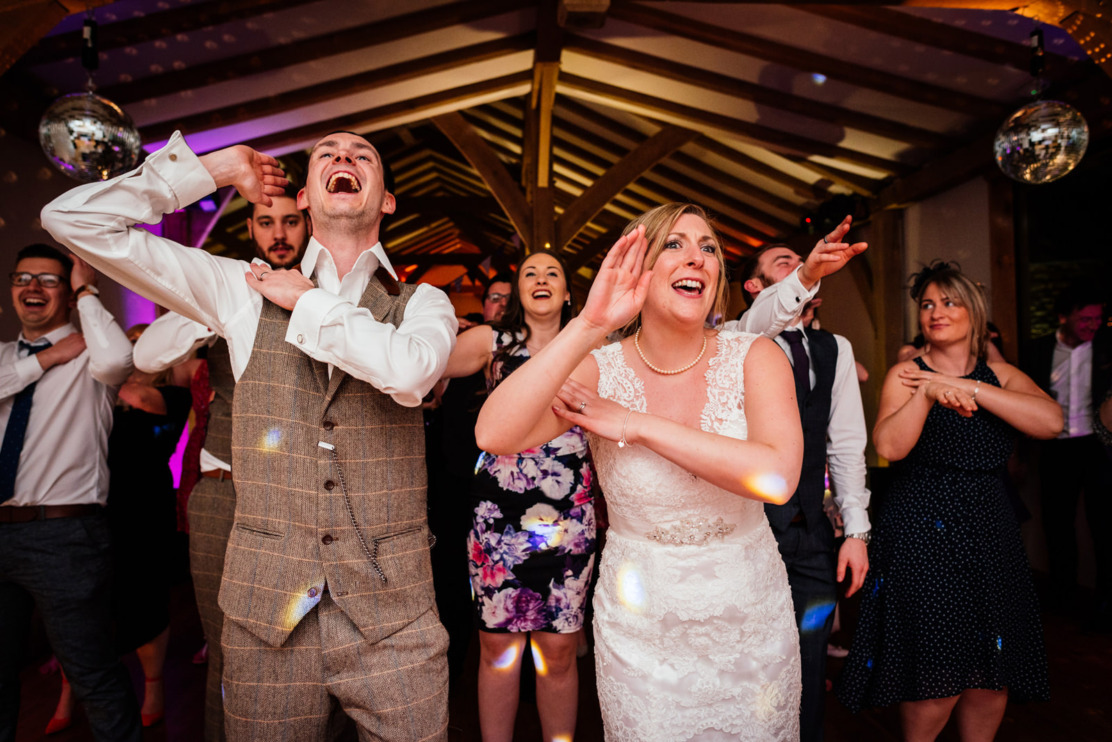 bride and groom and guest dancing to the macarena