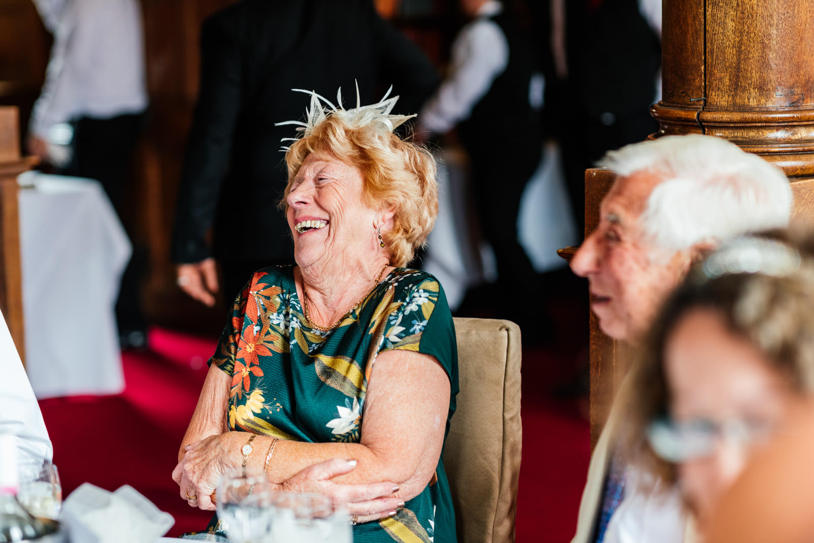 guest laughing during wedding breakfast