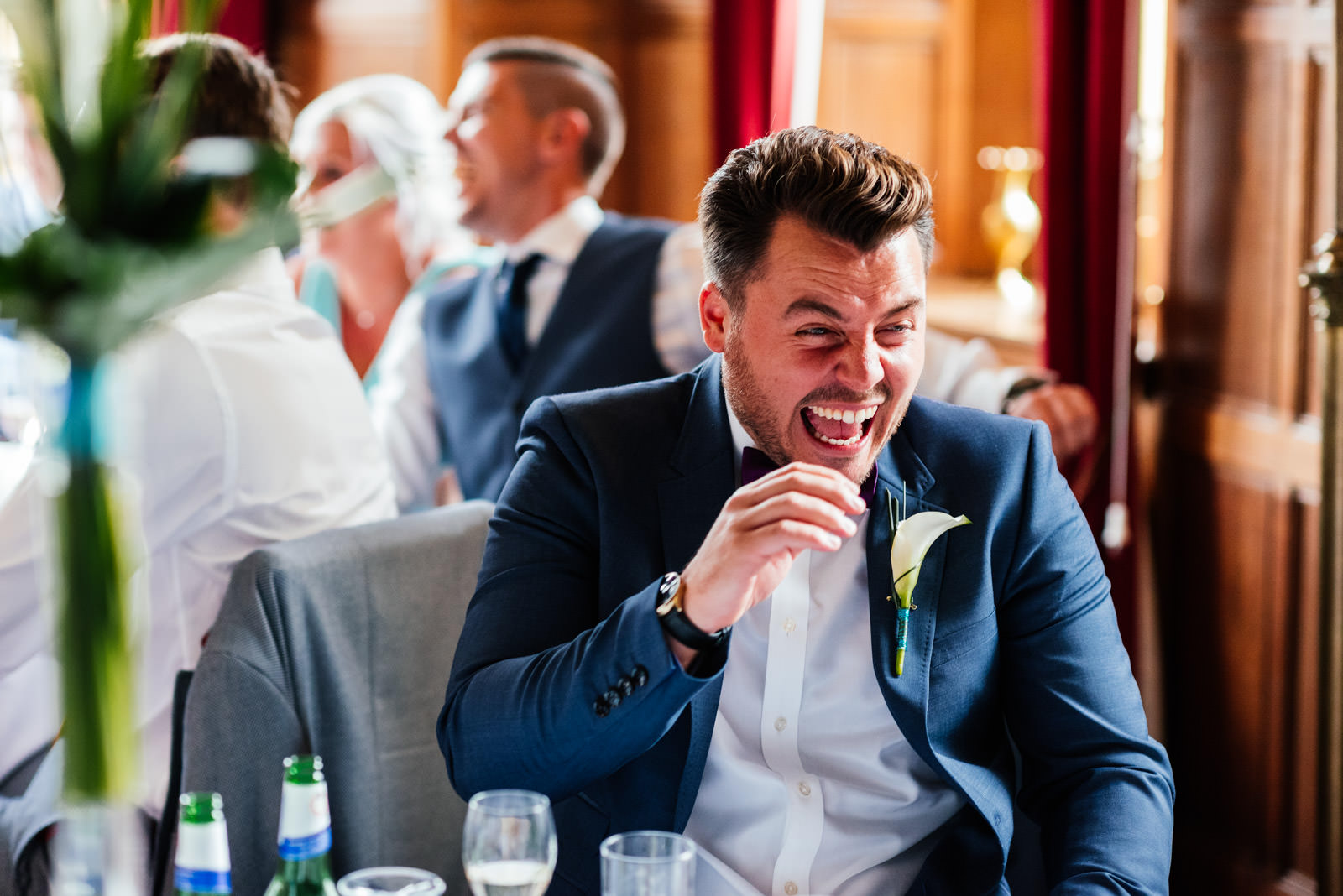 groom laughing during best man speech