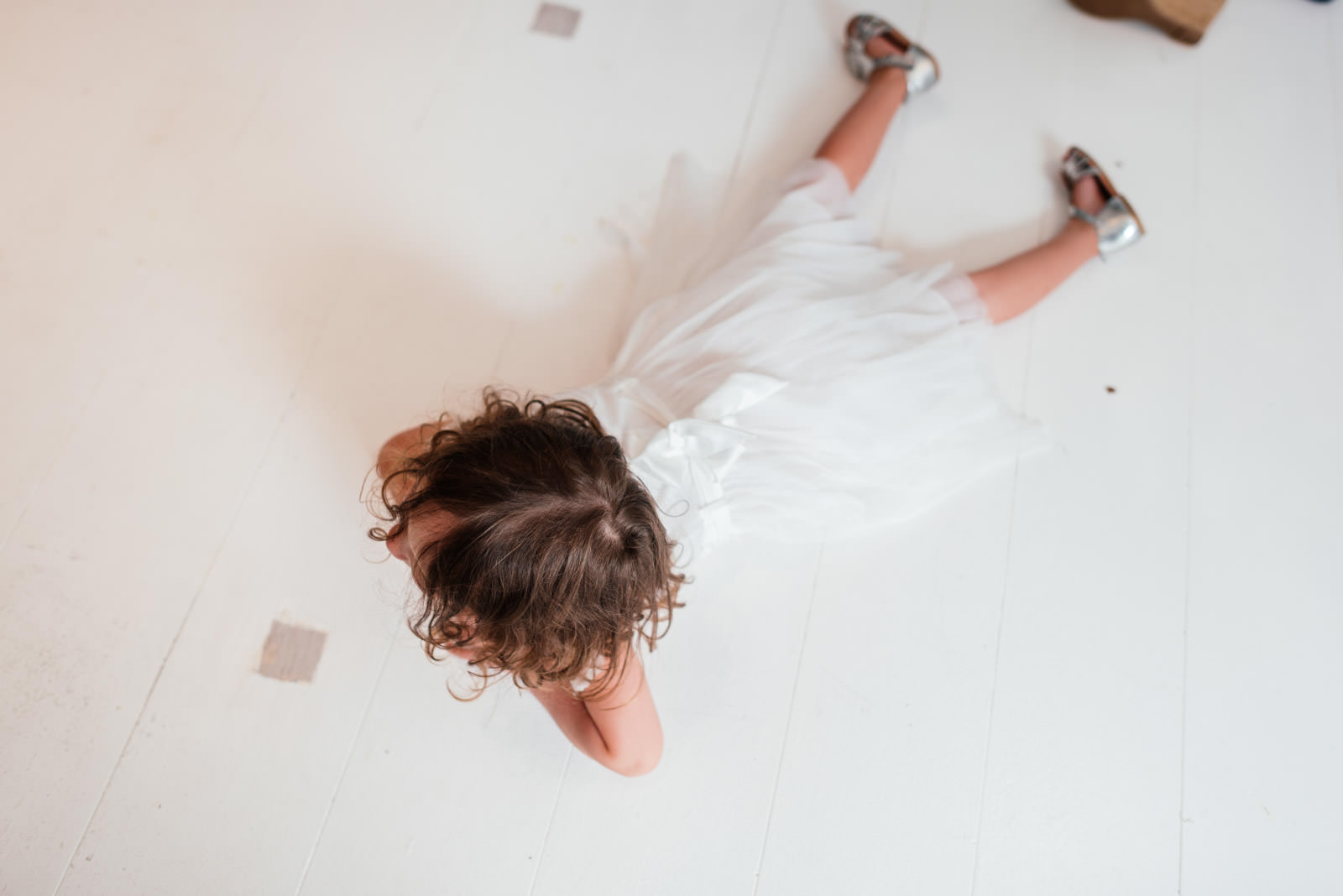 flower girl lying on the ground
