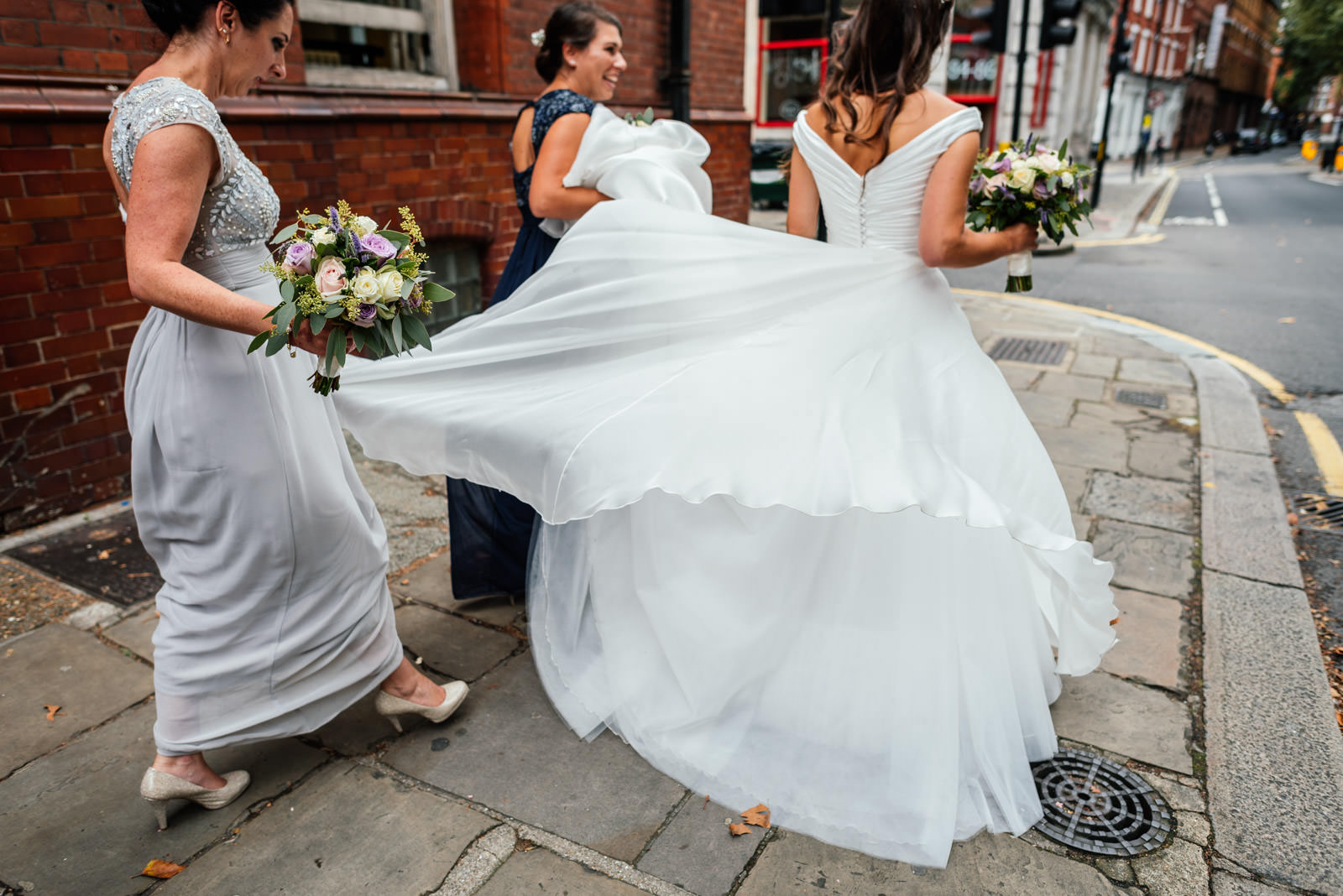 bride and bridesmaids walking in the street