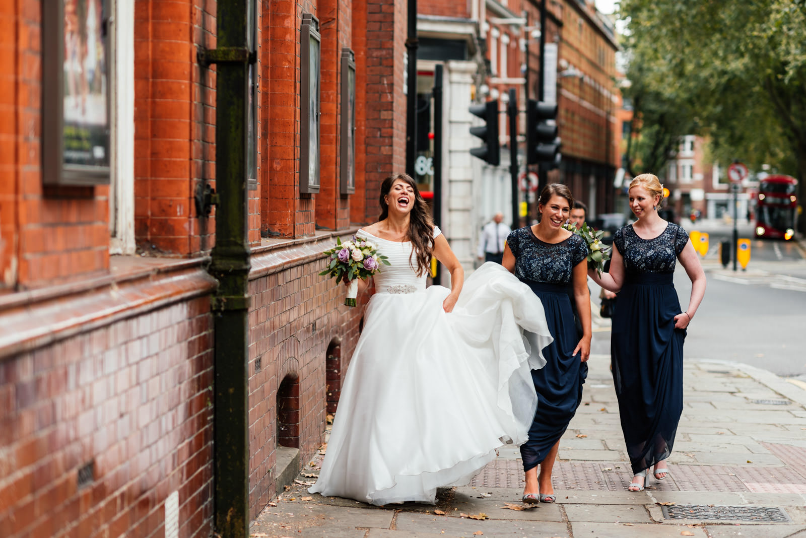 bride and bridesmaids laughing and walking