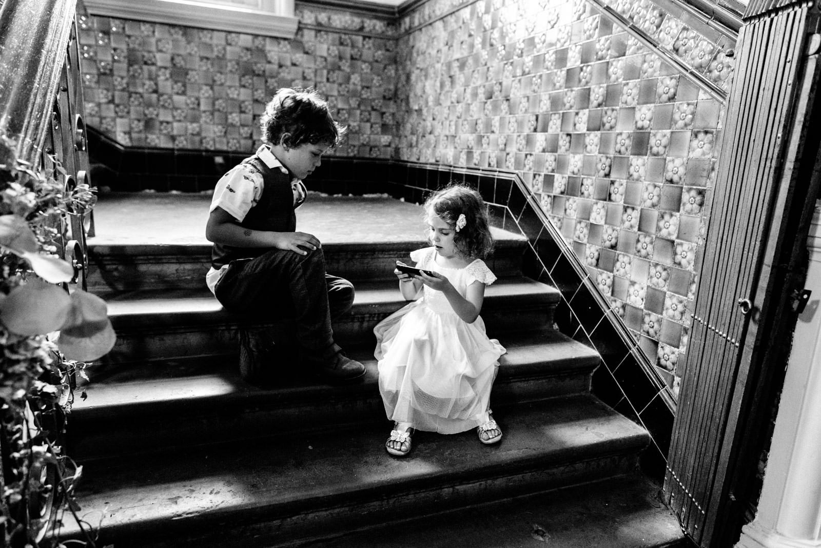 boy and flower girl playing on the stairs