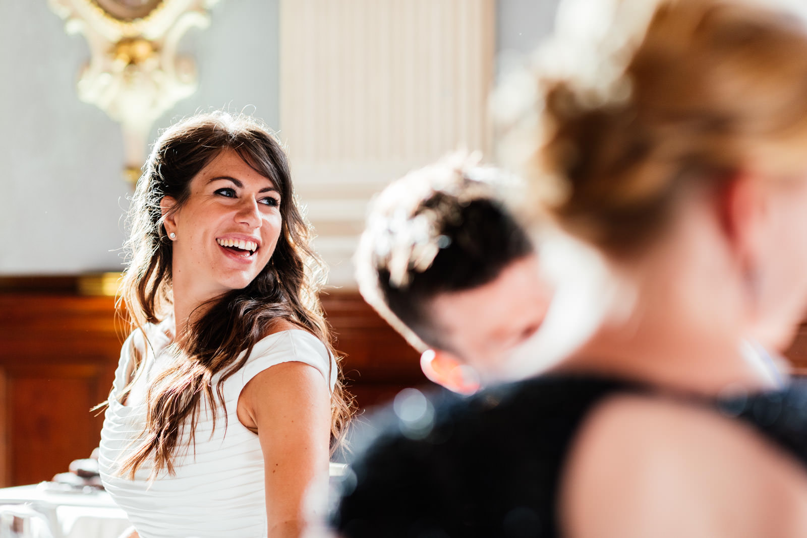 bride laughing during the speeches