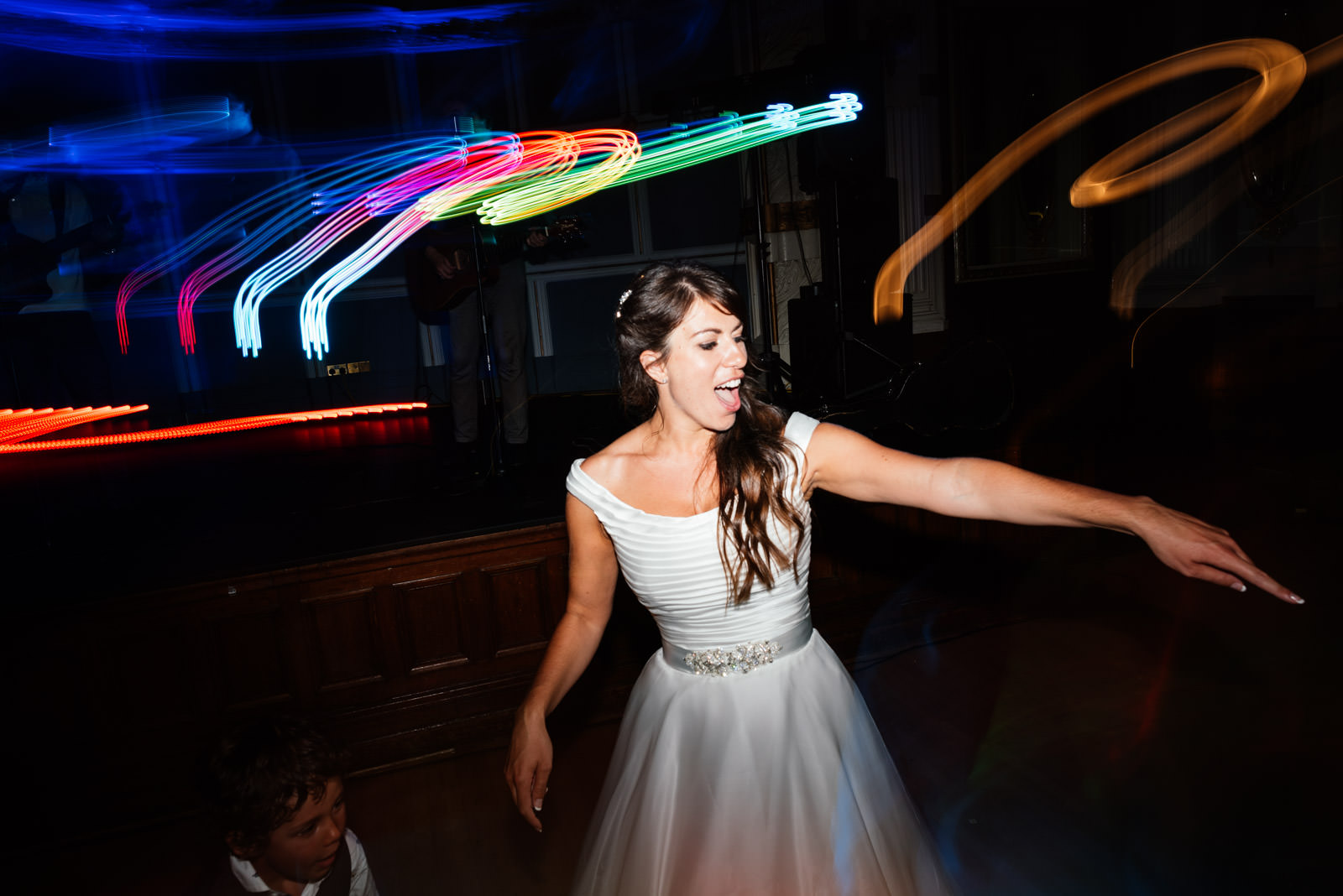 bride throwing shapes on the dance floor