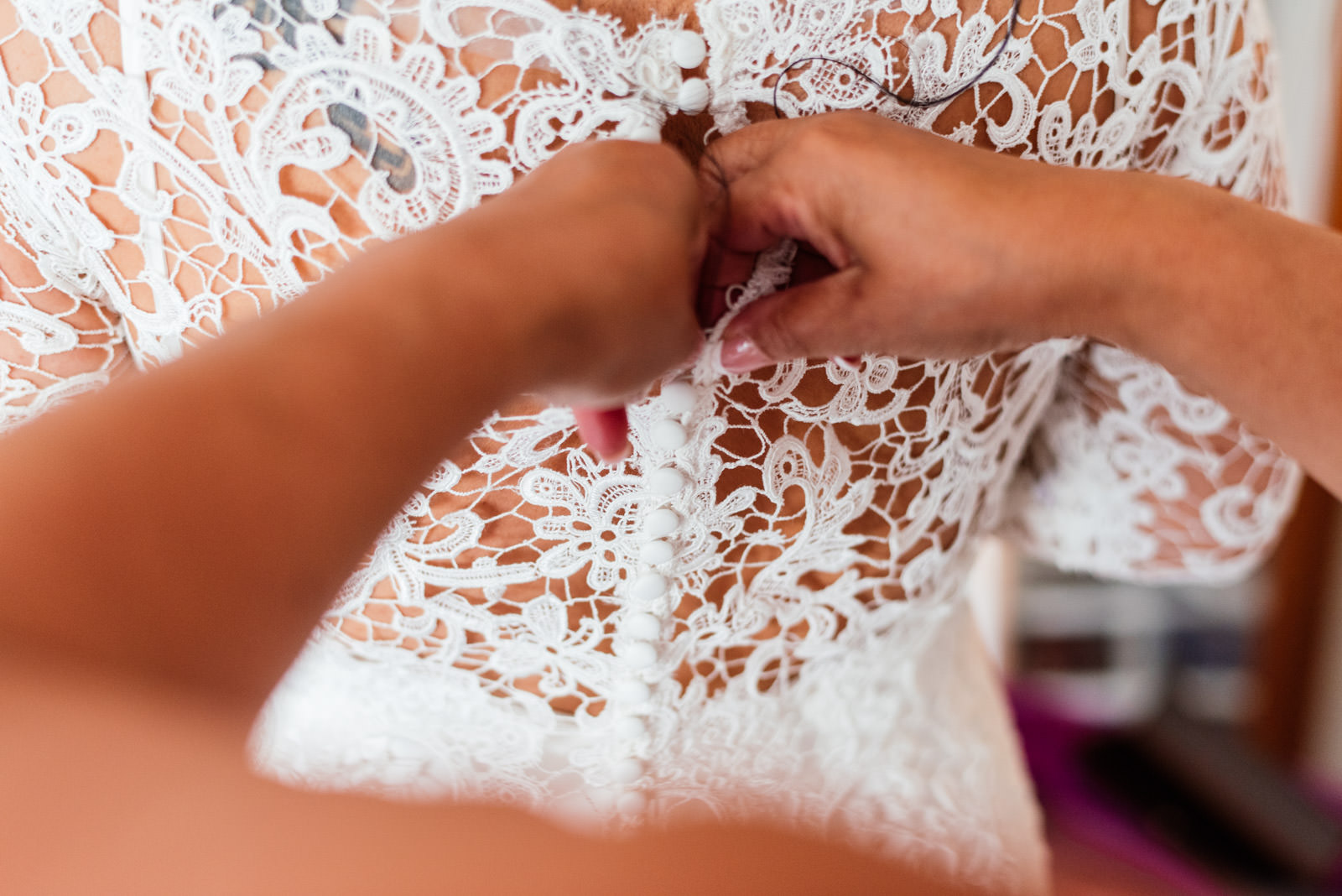 bride's dress being put on