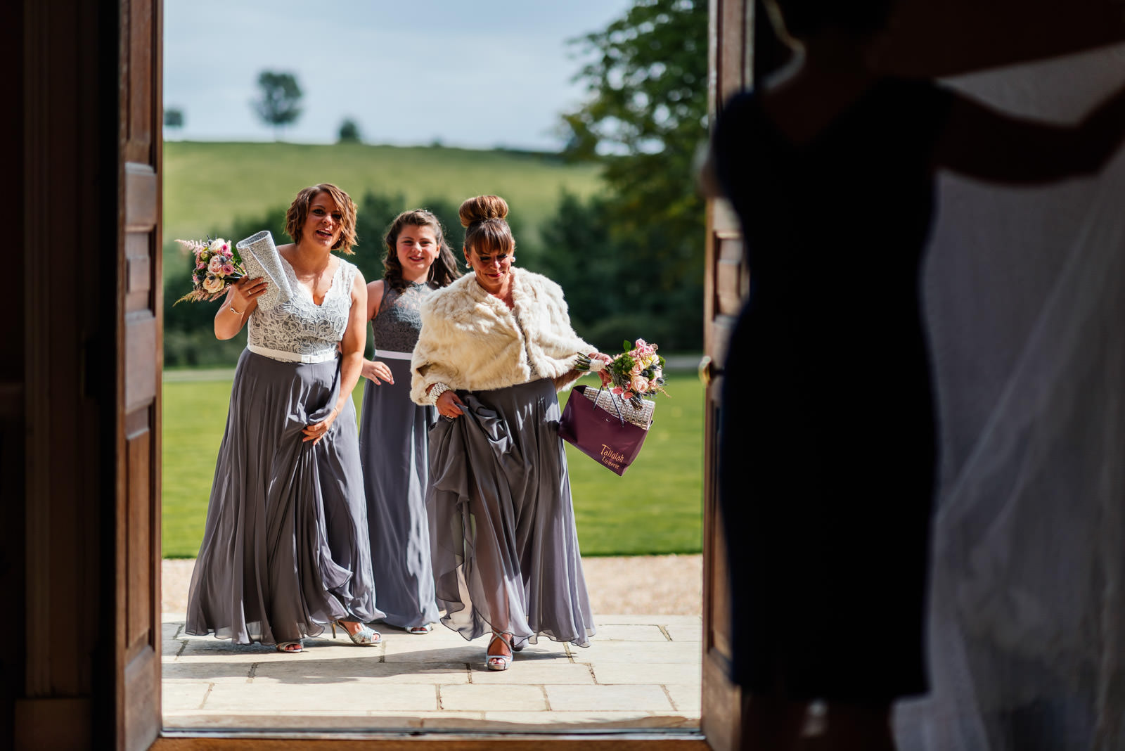 bridesmaids arriving at Kelmarsh Hall