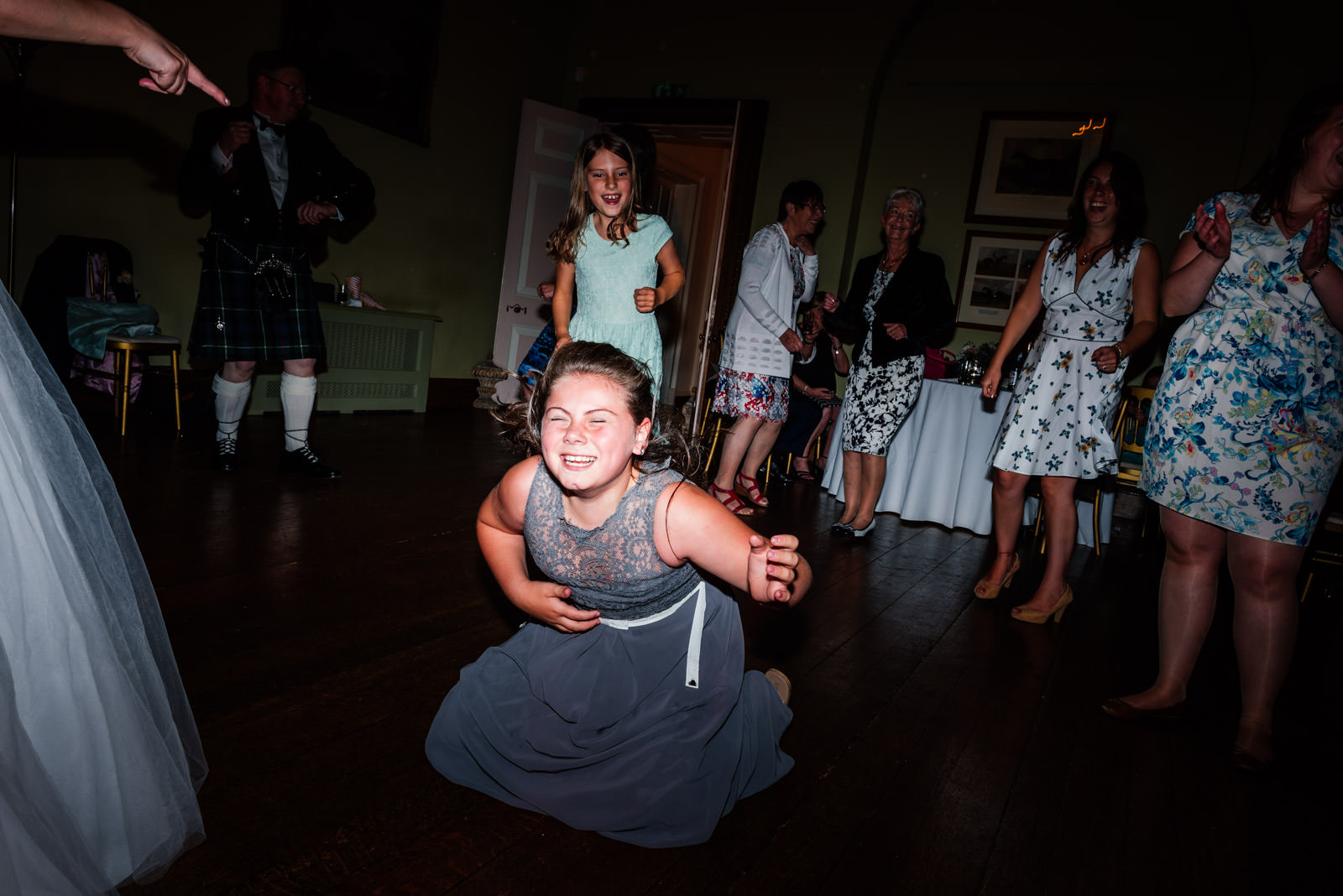 bridesmaid heading banging on the dance floor