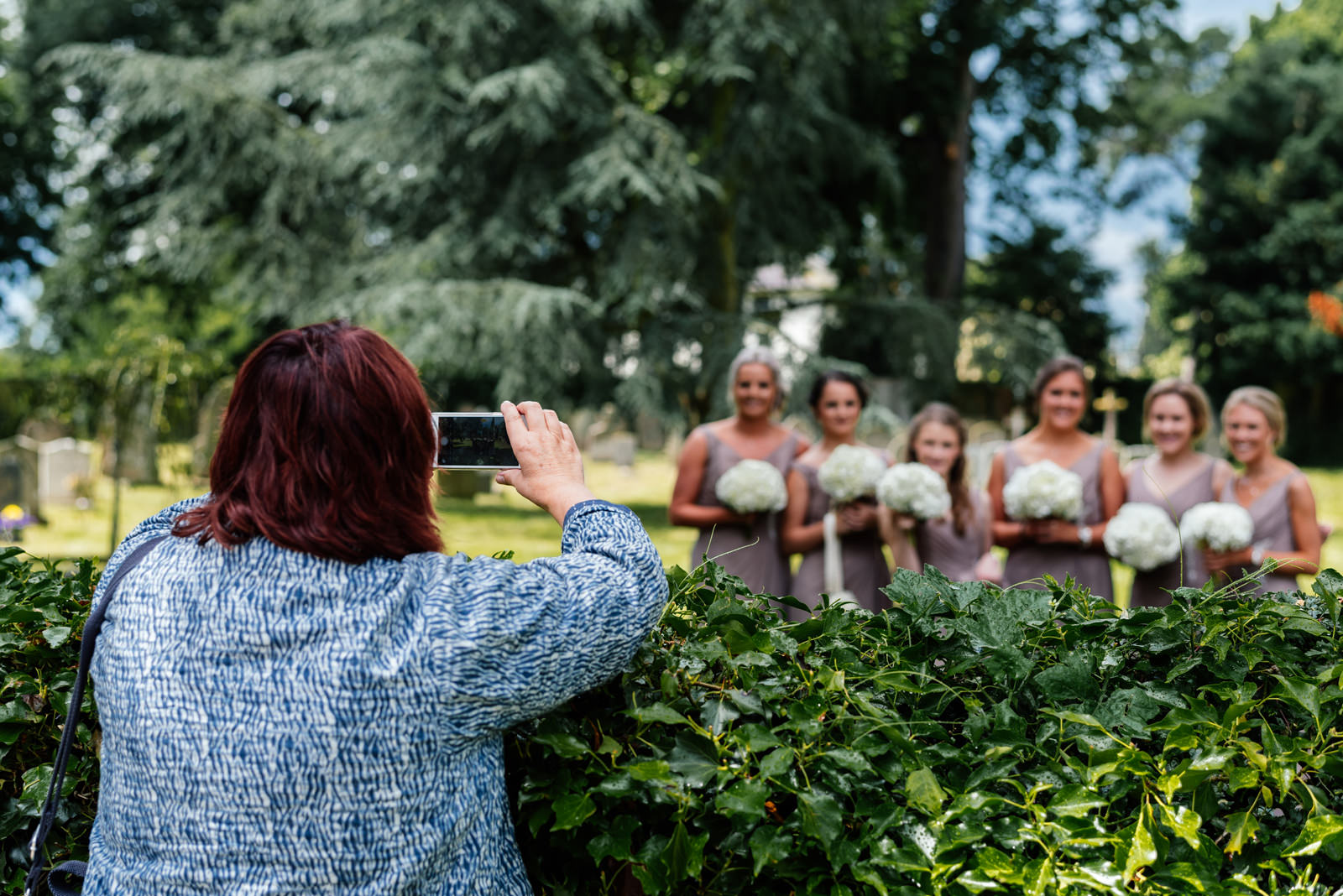 onlooking taking photo of bridesmaids