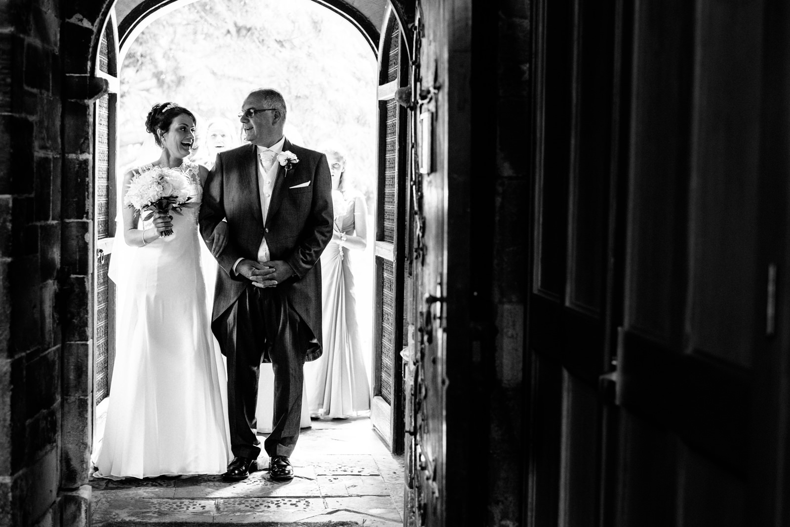 bride and father at entrance of church