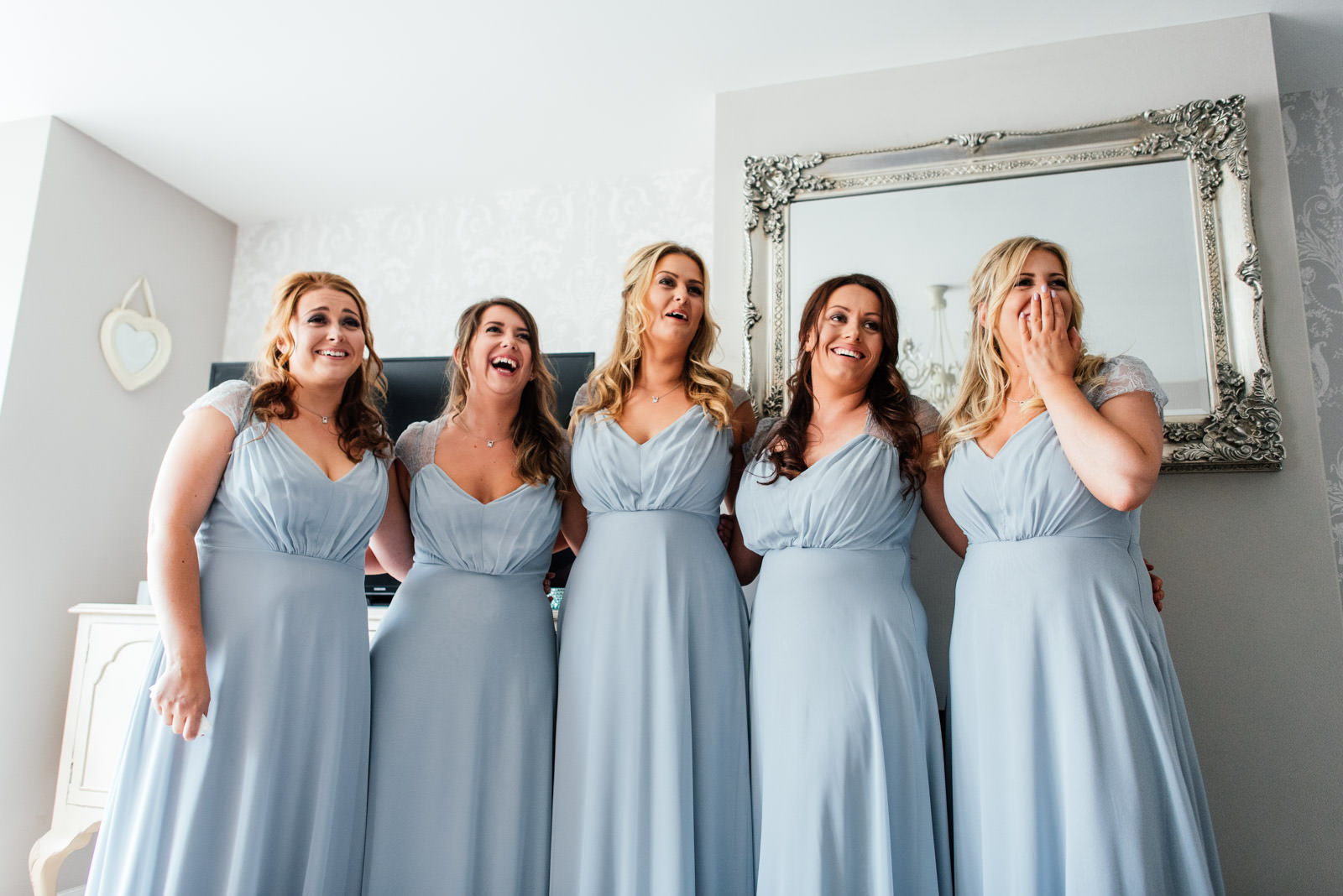 the big reveal to the bridesmaids