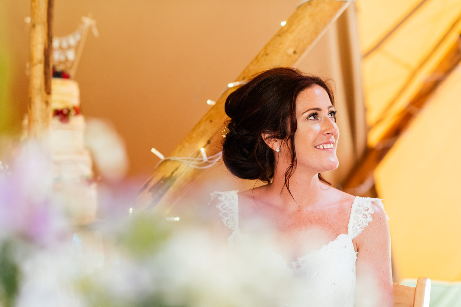 bride listening to her husband give speech